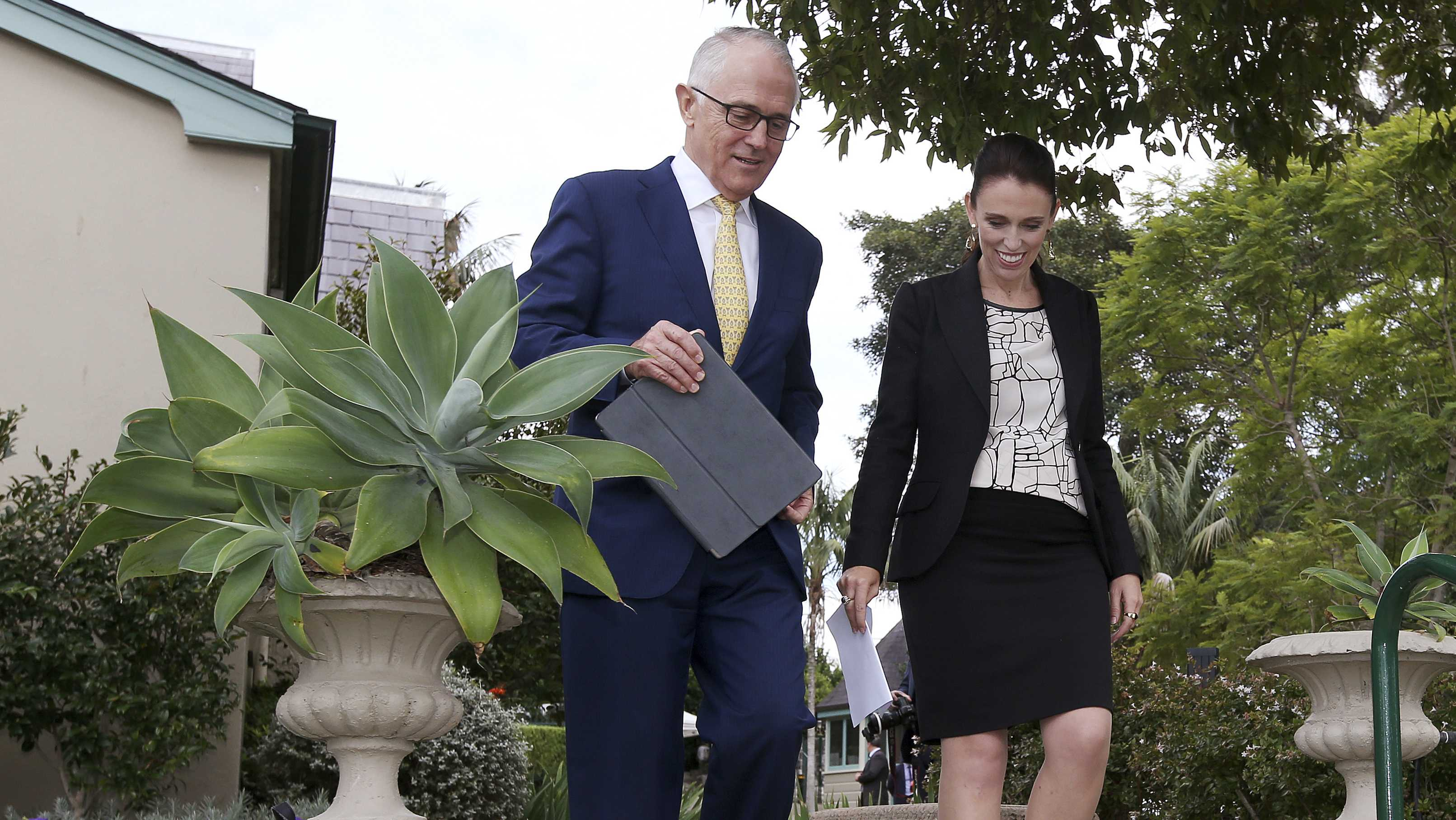 New Zealand's Prime Minister Jacinda Ardern, right, and Australian Prime Minister Malcolm Turnbull arrive to hold a joint press conference in Sydney, Friday, March 2, 2018.