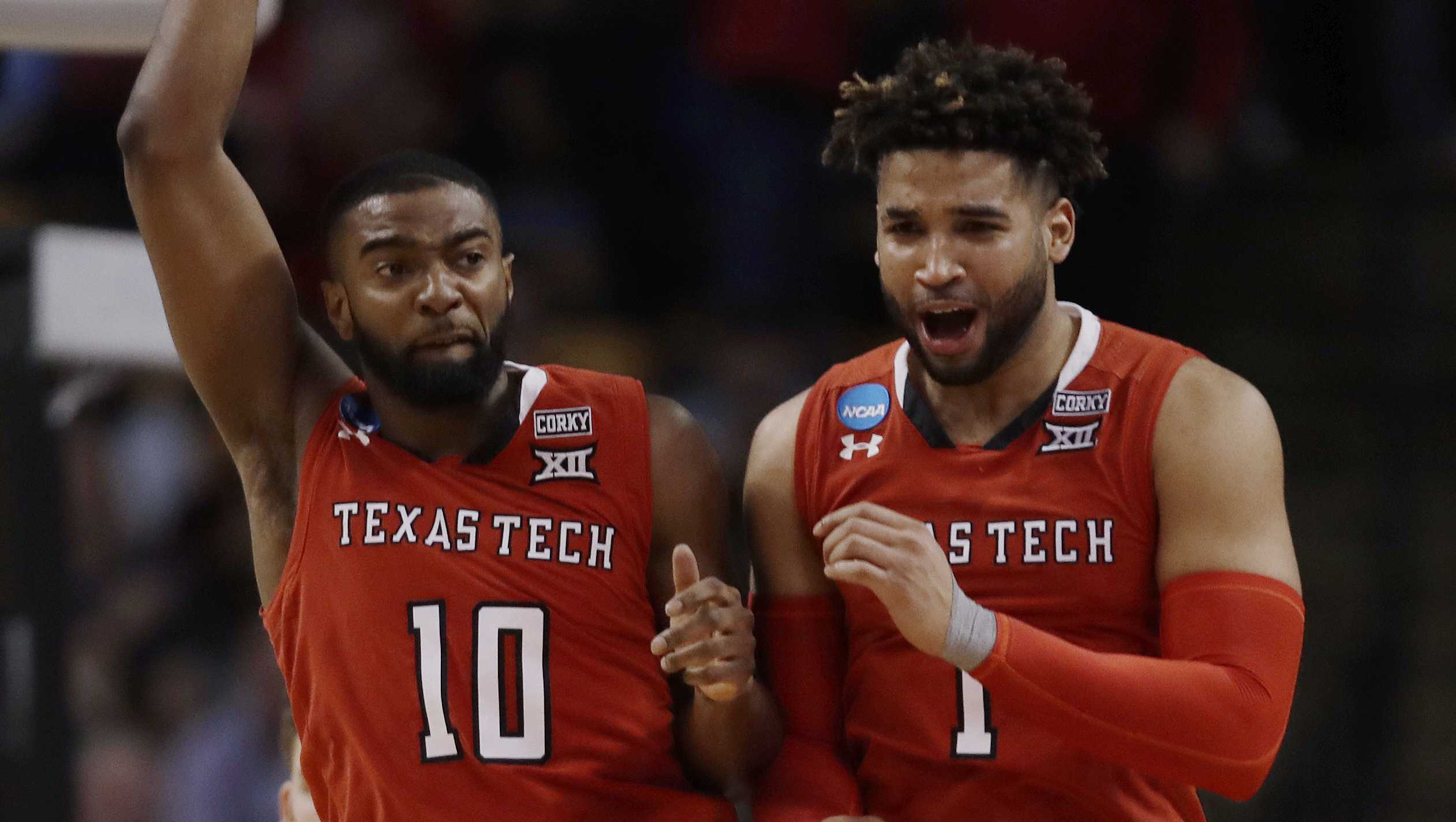 Texas Tech's Niem Stevenson, left, and Brandone Francis celebrate during the second half of the team's NCAA men's college basketball tournament regional semifinal against Purdue, Friday, March 23, 2018, in Boston.