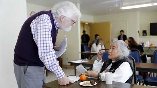 In this Friday, April 13, 2018 photo, Patrick Arbore, left, talks to Corazon Leano as he conducts an anti-bullying class at the On Lok 30th Street Senior Center in San Francisco. Nursing homes, senior centers and other places older adults gather are confronting a problem long thought the domain of the young: Bullying.