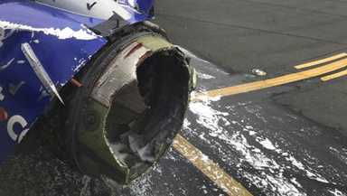 This April 17, 2018 photo provided by Marty Martinez shows the jet engine casing of a Southwest Airlines airplane