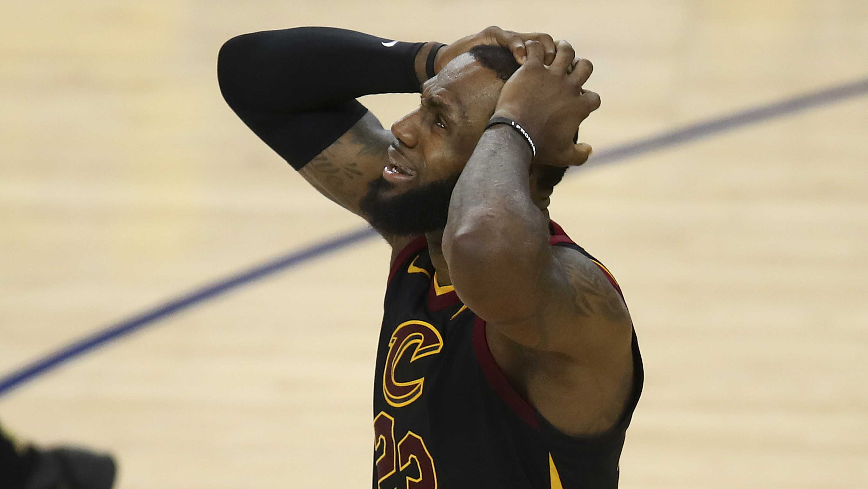 Cleveland Cavaliers forward LeBron James reacts to a call during the second half of Game 1 of basketball's NBA Finals between the Golden State Warriors and the Cavaliers in Oakland, Calif., Thursday, May 31, 2018.