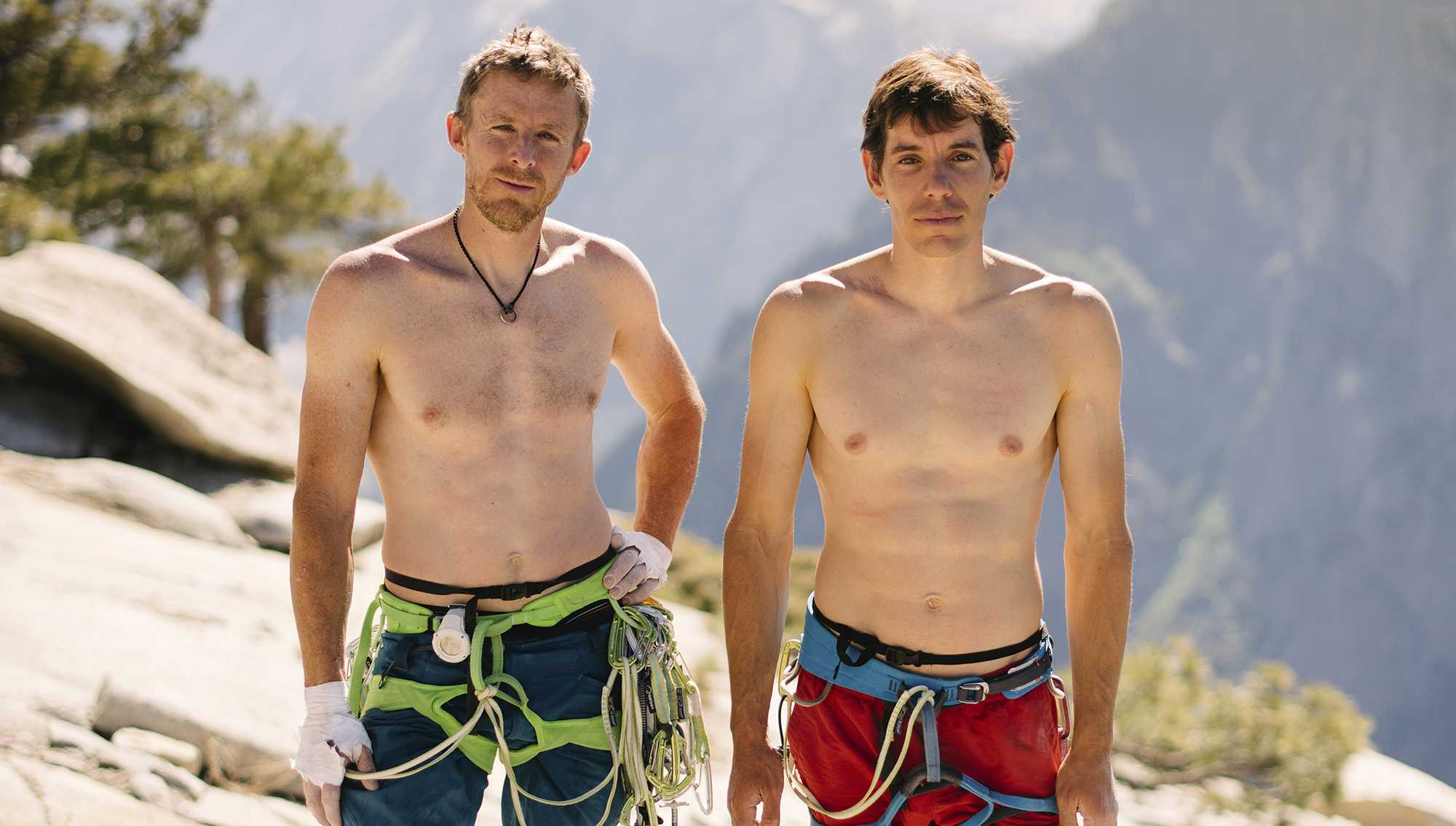In this June 3, 2018 photo provided by Corey Rich, Alex Honnold, right, and Tommy Caldwell pose for a portrait at the top of El Capitan in Yosemite National Park, Calif. Days after two of the world's most celebrated rock climbers twice set astonishingly fast records on the biggest wall in Yosemite National Park, they did it again Wednesday, June 6, 2018, breaking a mark compared with track's four-minute mile.