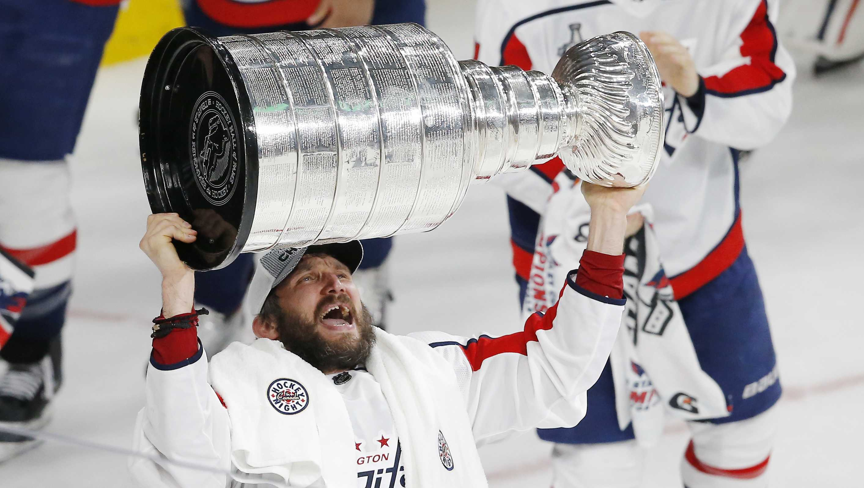 Washington Capitals left wing Alex Ovechkin, of Russia, hoists the Stanley Cup after the Capitals defeated the Vegas Golden Knights 4-3 in Game 5 of the NHL hockey Stanley Cup Finals Thursday, June 7, 2018, in Las Vegas.
