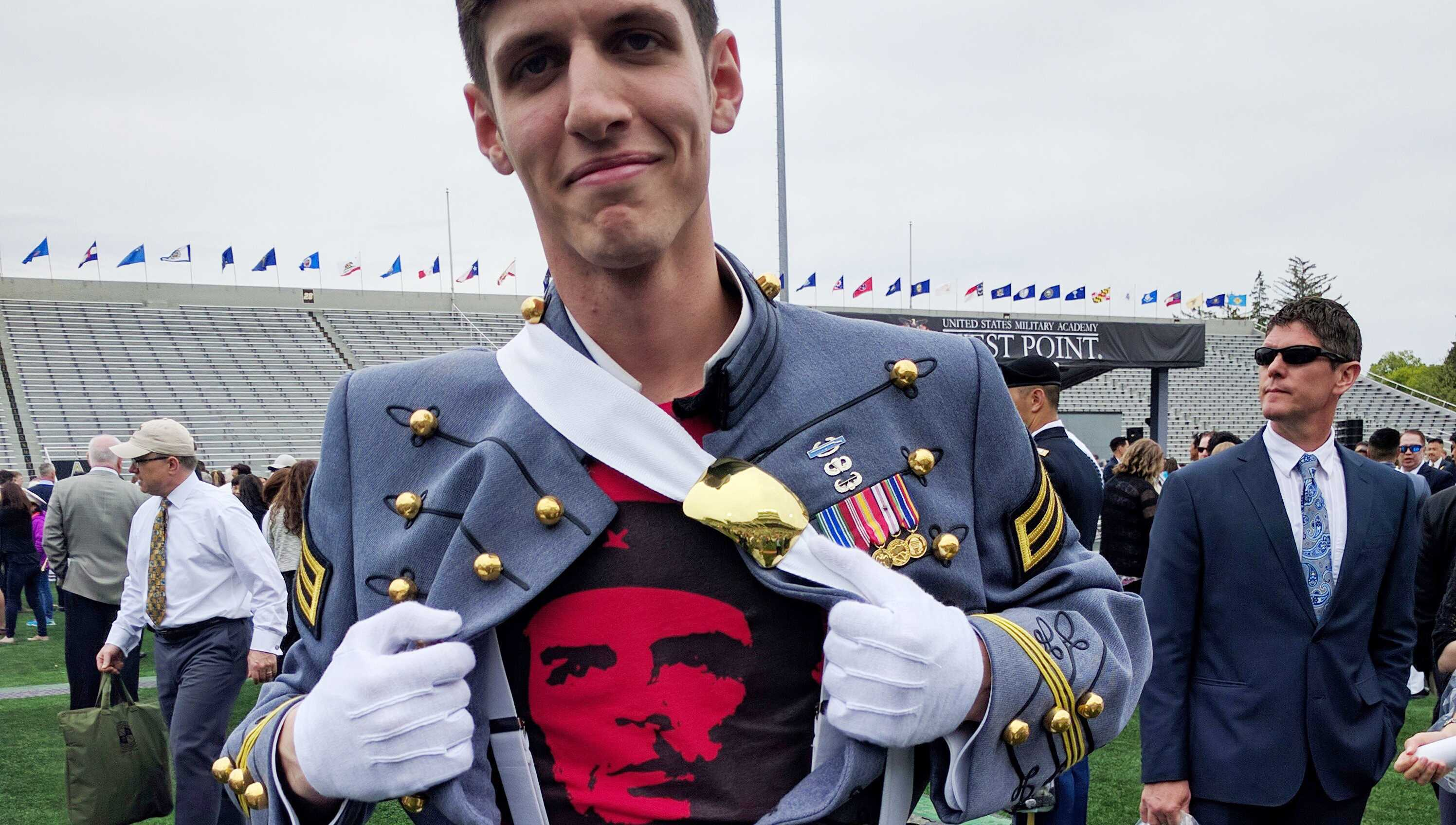 In this May 2016 photo provided by Spenser Rapone, Rapone displays a shirt bearing the image of socialist icon Che Guevara under his uniform, after graduating from the United States Military Academy at West Point, N.Y.