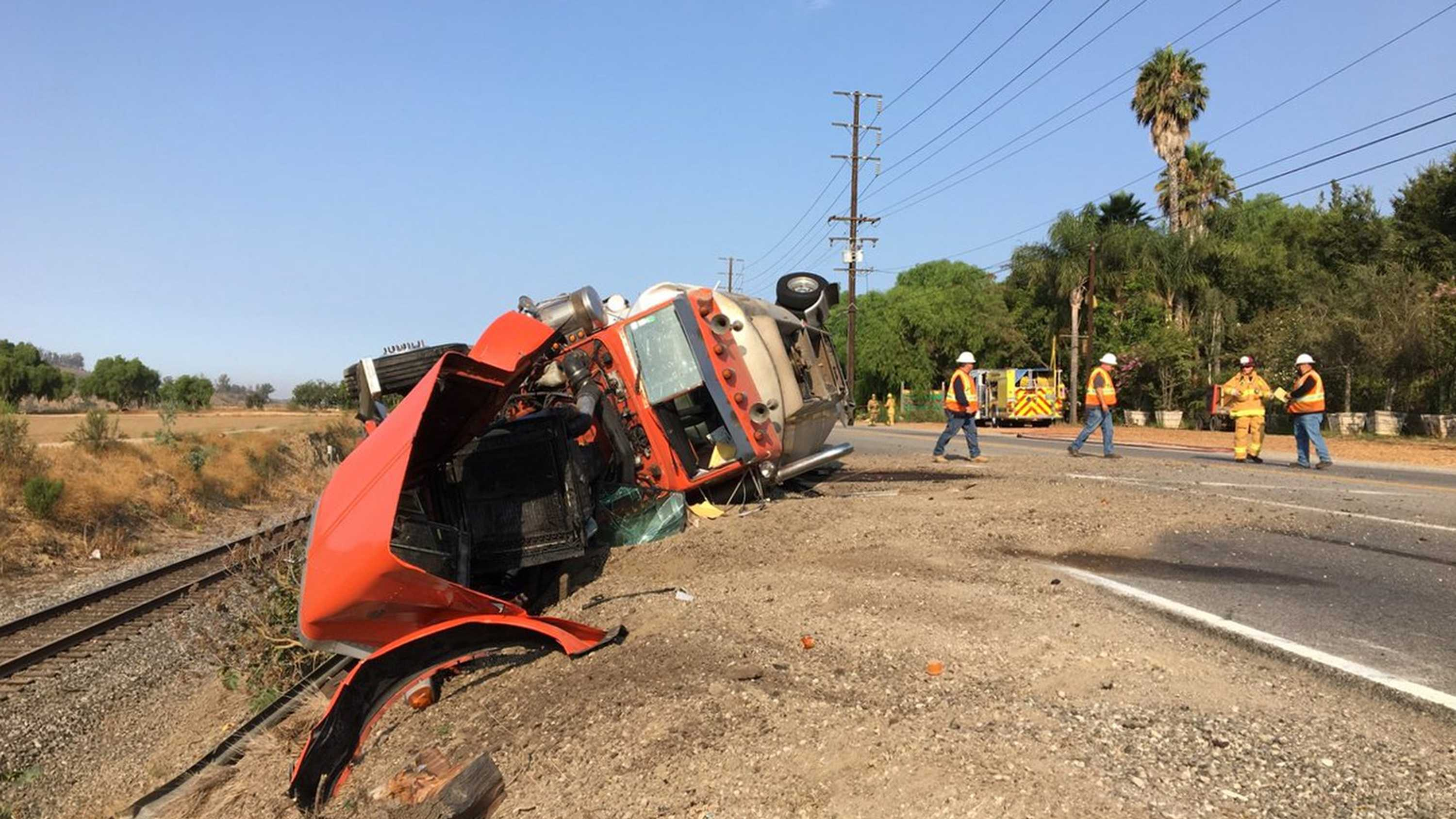 In this Friday, Aug. 9, 2018, photo released by the California Department of Transportation, shows Caltrans District 7, workers clean up a hazardous spill on SR-118 in Ventura County from an earlier accident this morning. The tanker truck hit a car carrying a woman and two children on a Ventura County highway, killing a 9-year-old boy and seriously injuring a 7-year-old girl and both drivers involved.