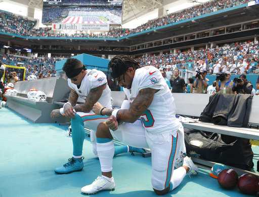 Dolphins players first in NFL to take knee as season begins