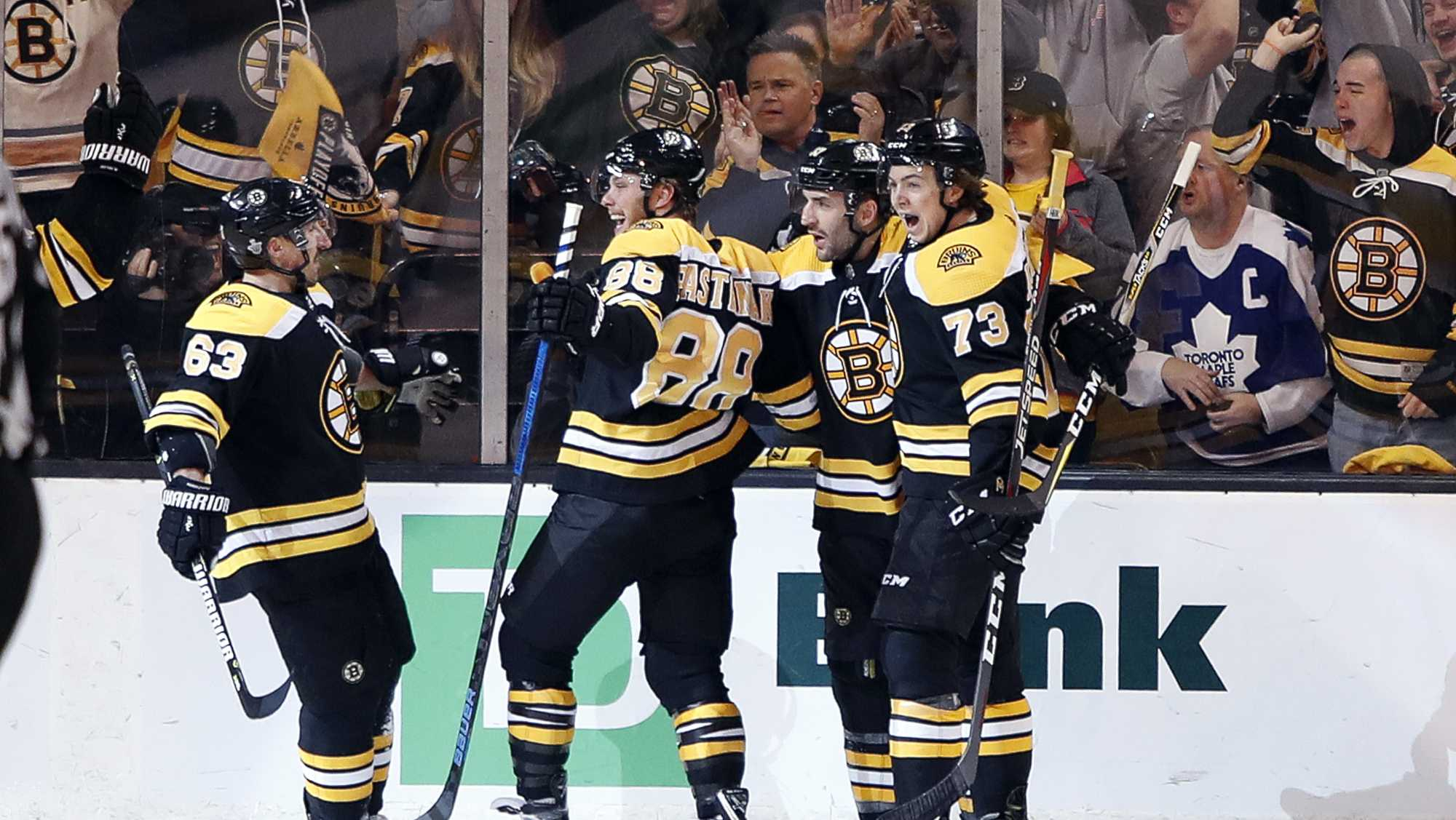 Boston Bruins' Brad Marchand, David Pastrnak, Patrice Bergeron and Charlie McAvoy, from left, celebrate after Pastrnak scored against the Toronto Maple Leafs during the first period of Game 2 of an NHL hockey first-round playoff series in Boston Saturday, April 14, 2018.