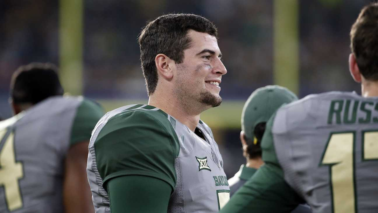 Baylor quarterback Jarrett Stidham smiles as he talks with teammates on the sideline during an NCAA college football game against Texas Tech Saturday, Oct. 3, 2015, in Arlington, Texas.