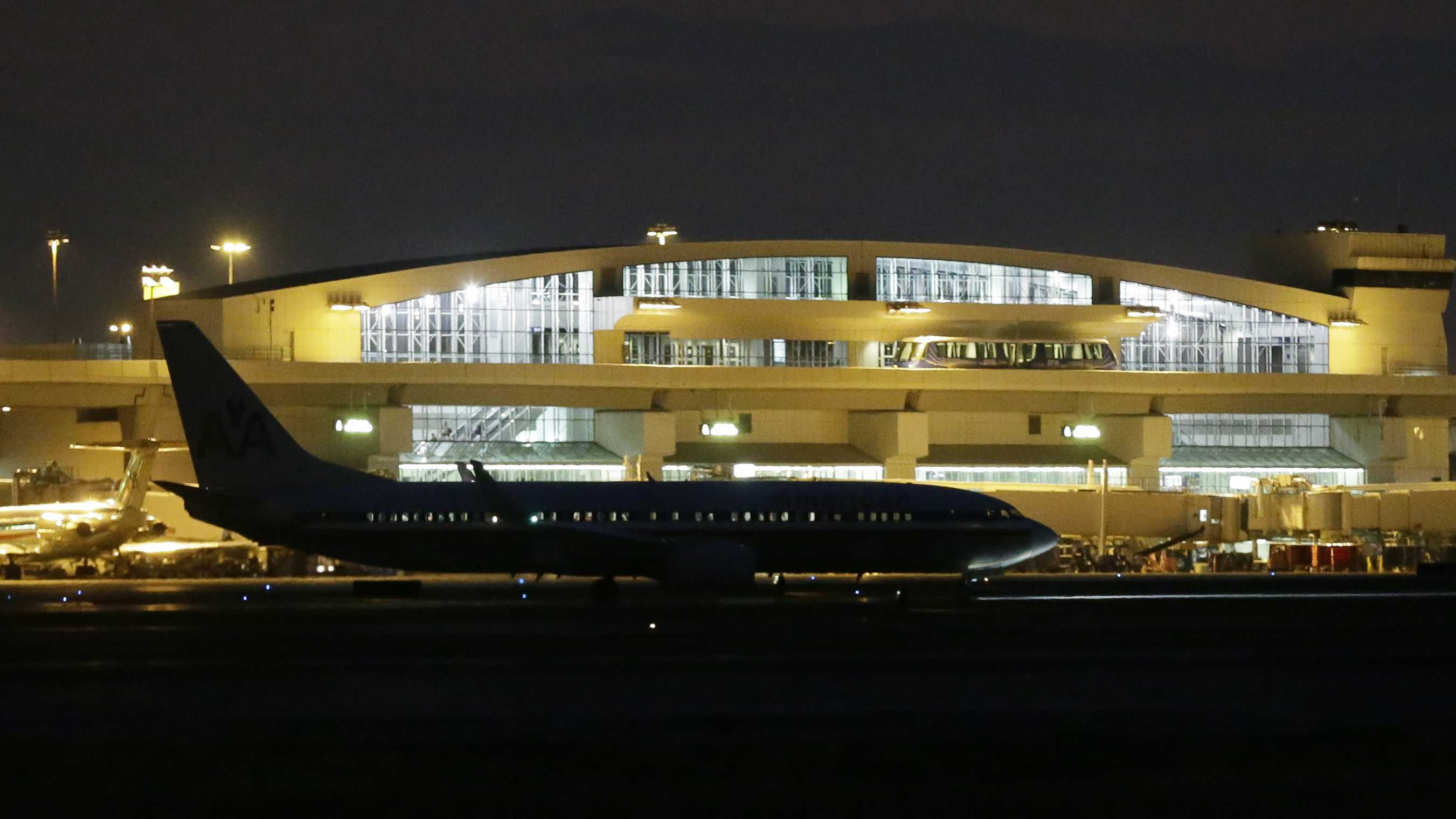 In this Aug. 25, 2015 photo, a passenger jet taxis past a terminal after arriving at Dallas/Fort Worth International Airport in Grapevine, Texas. Each day, more than 170,000 passengers use the airport, making it the ninth busiest in the world.