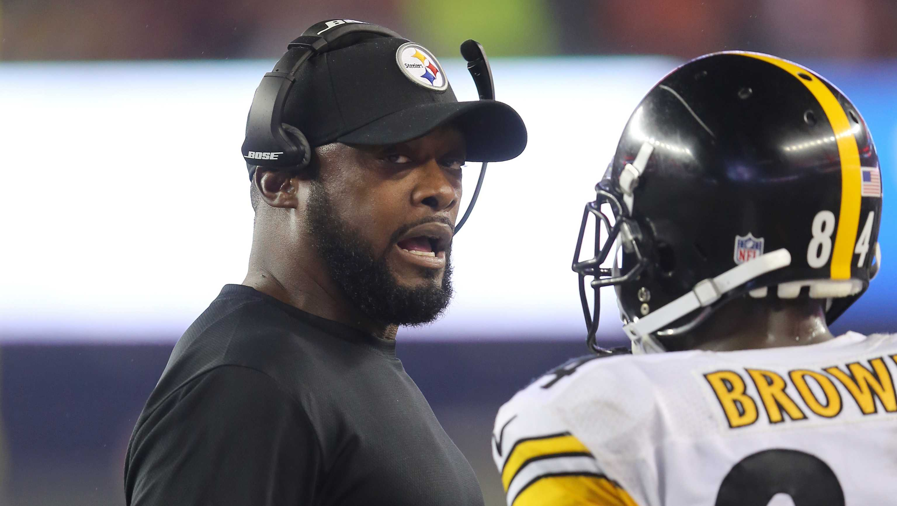 Pittsburgh Steelers head coach Mike Tomlin is seen with Antonio Brown #84 on the sidelines against the New England Patriots during an NFL football game, Thursday, Sept. 10, 2015, in Foxborough, Mass.