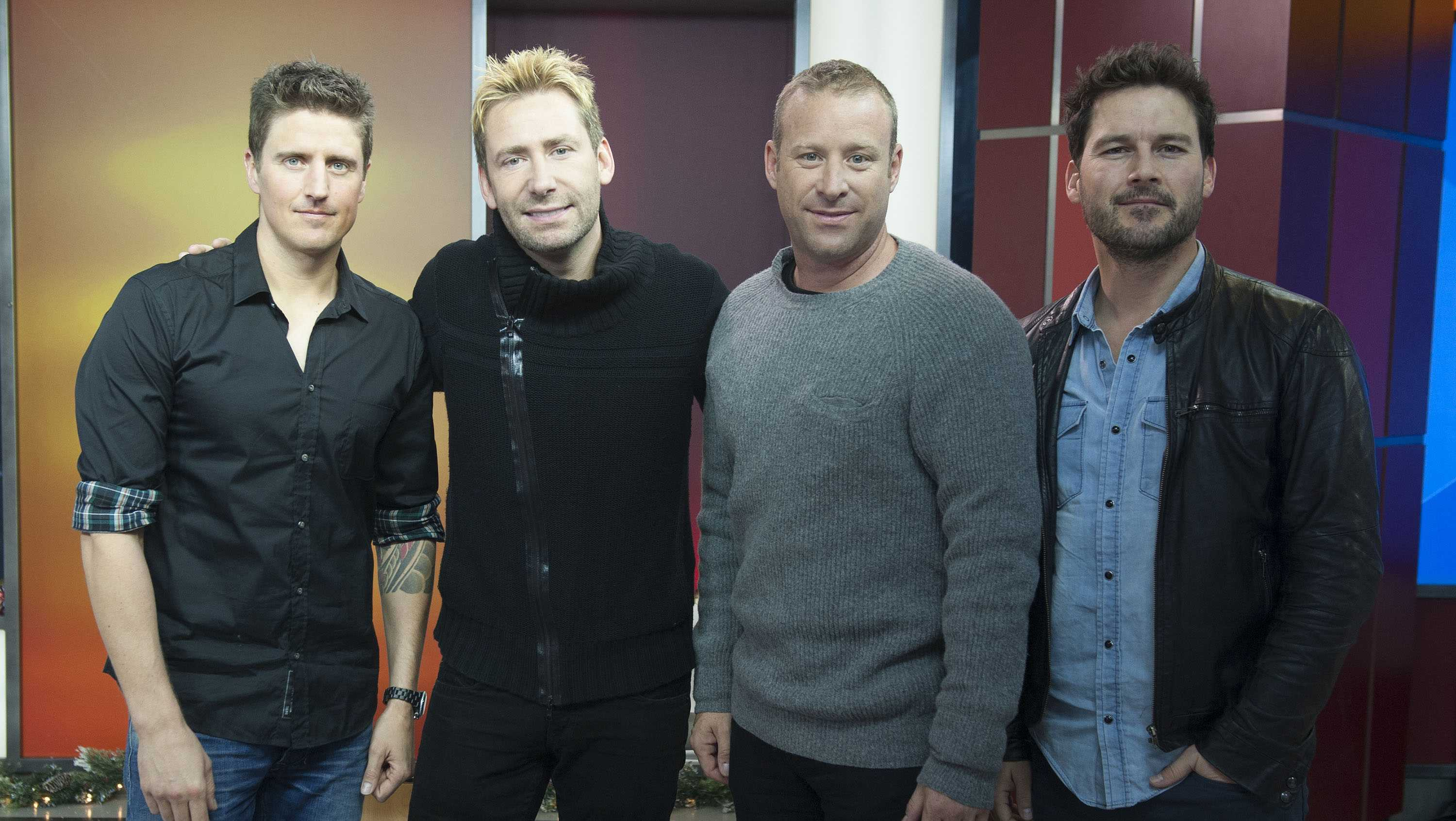 Musician Daniel Adair, singer Chad Kroeger and musicians Mike Kroeger and Ryan Peake of Nickelback seen on The Morning Show on Thursday, Nov. 21, 2014 in Toronto, Canada.