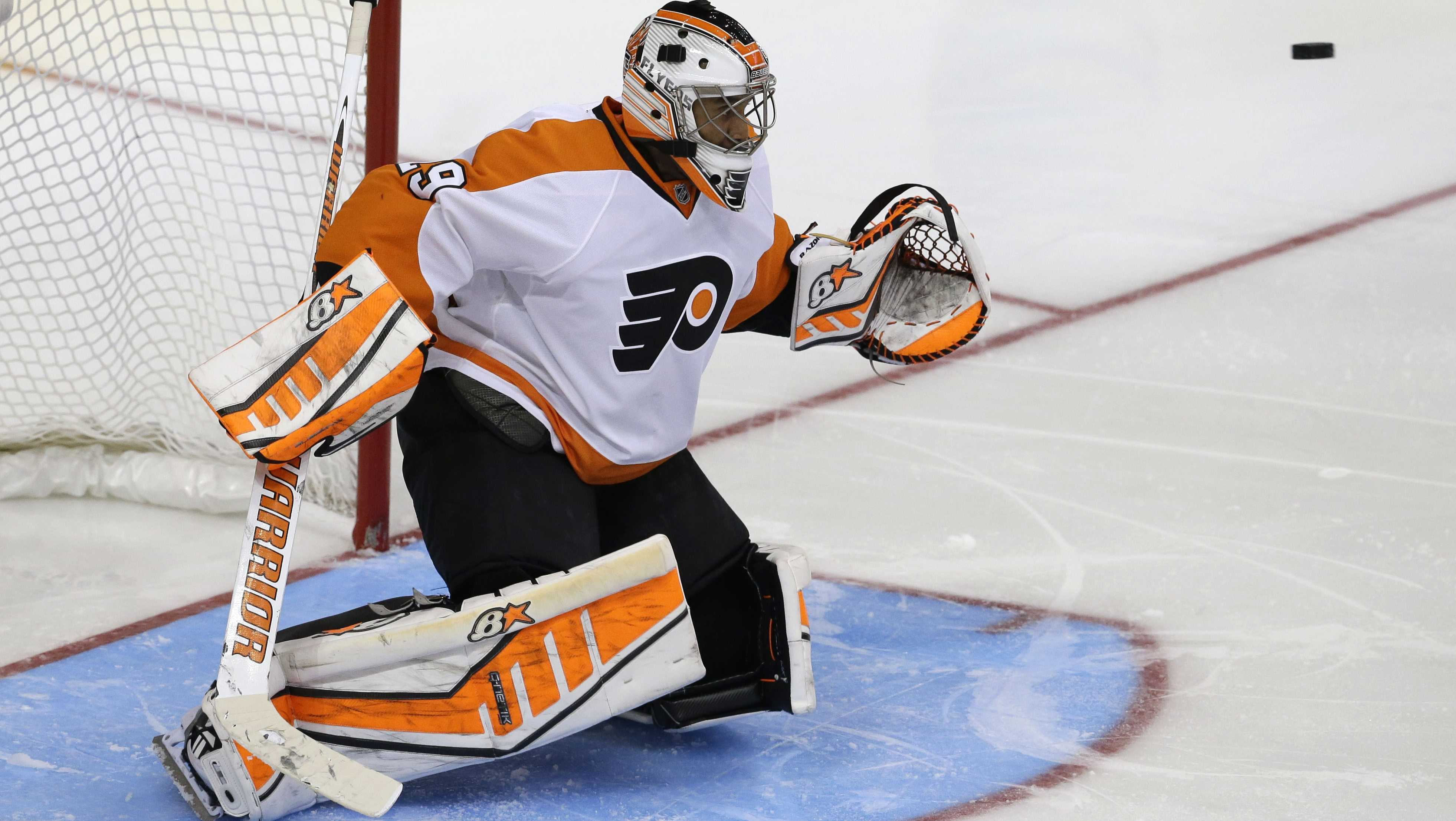 Philadelphia Flyers goalie Ray Emery (29) defends the goal during the third period of an NHL hockey game against the Dallas Stars Saturday, Oct. 18, 2014, in Dallas. The Flyers won 6-5 in overtime.