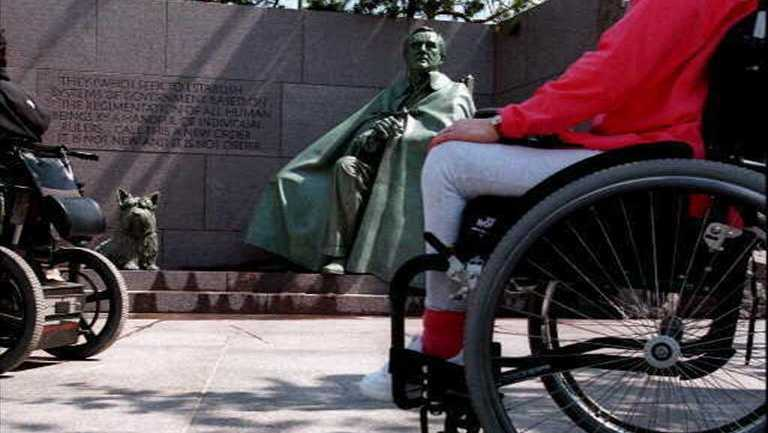 Wheelchair-bound visitors tour Franklin D. Roosevelt Memorial, Washington DC, photo