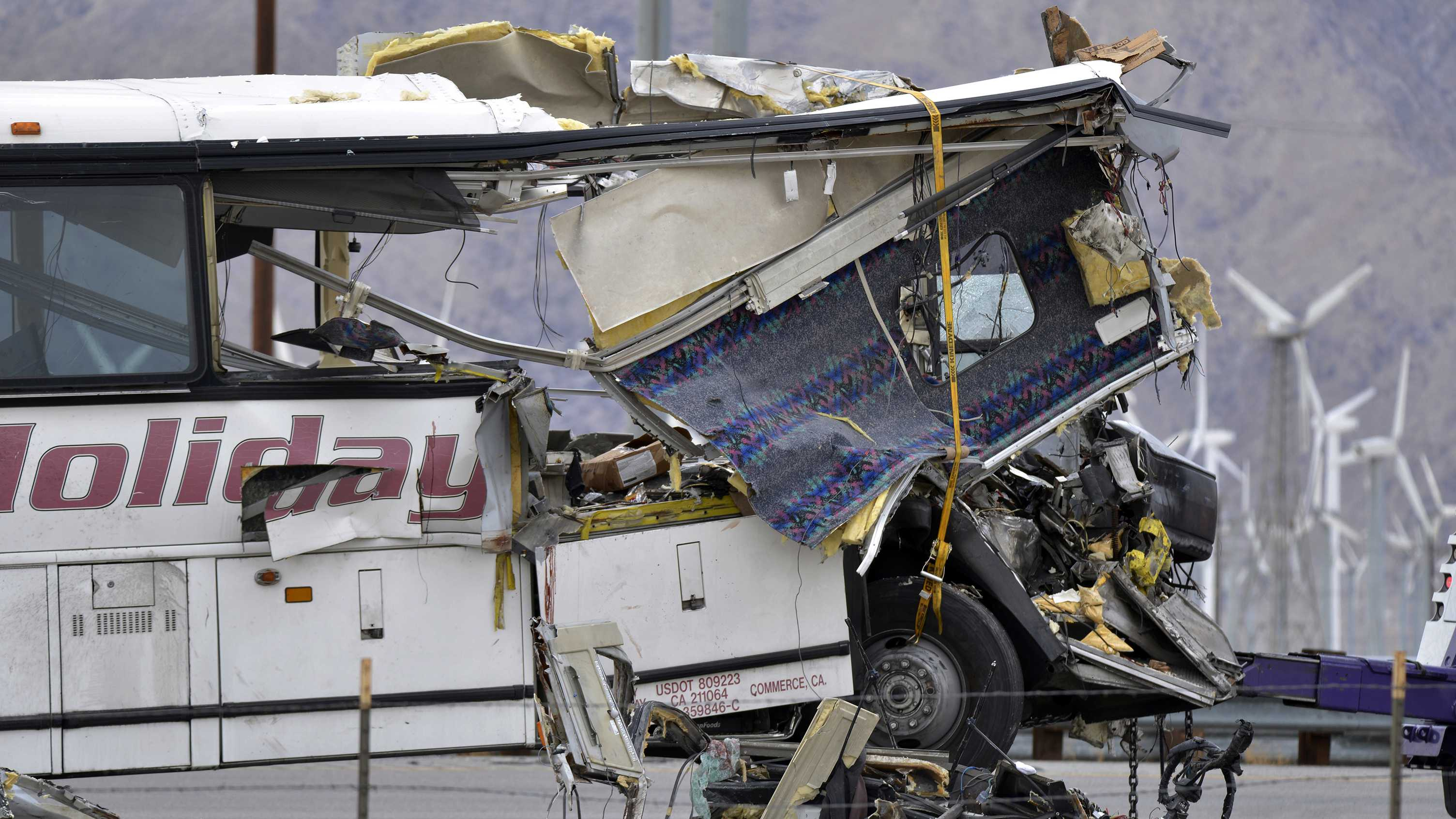 This Oct. 23, 2016 file photo shows the wreckage of a tour bus that collided with a big rig on Interstate 10 in Desert Hot Springs, Calif., near Palm Springs, Calif. The crash killed 13 people and injured over two dozen. Bus tours have been a fixture across the American landscape for years, shuttling gamblers from cities to rural places where casinos are located, particularly in California where tribal operations are often hours away.