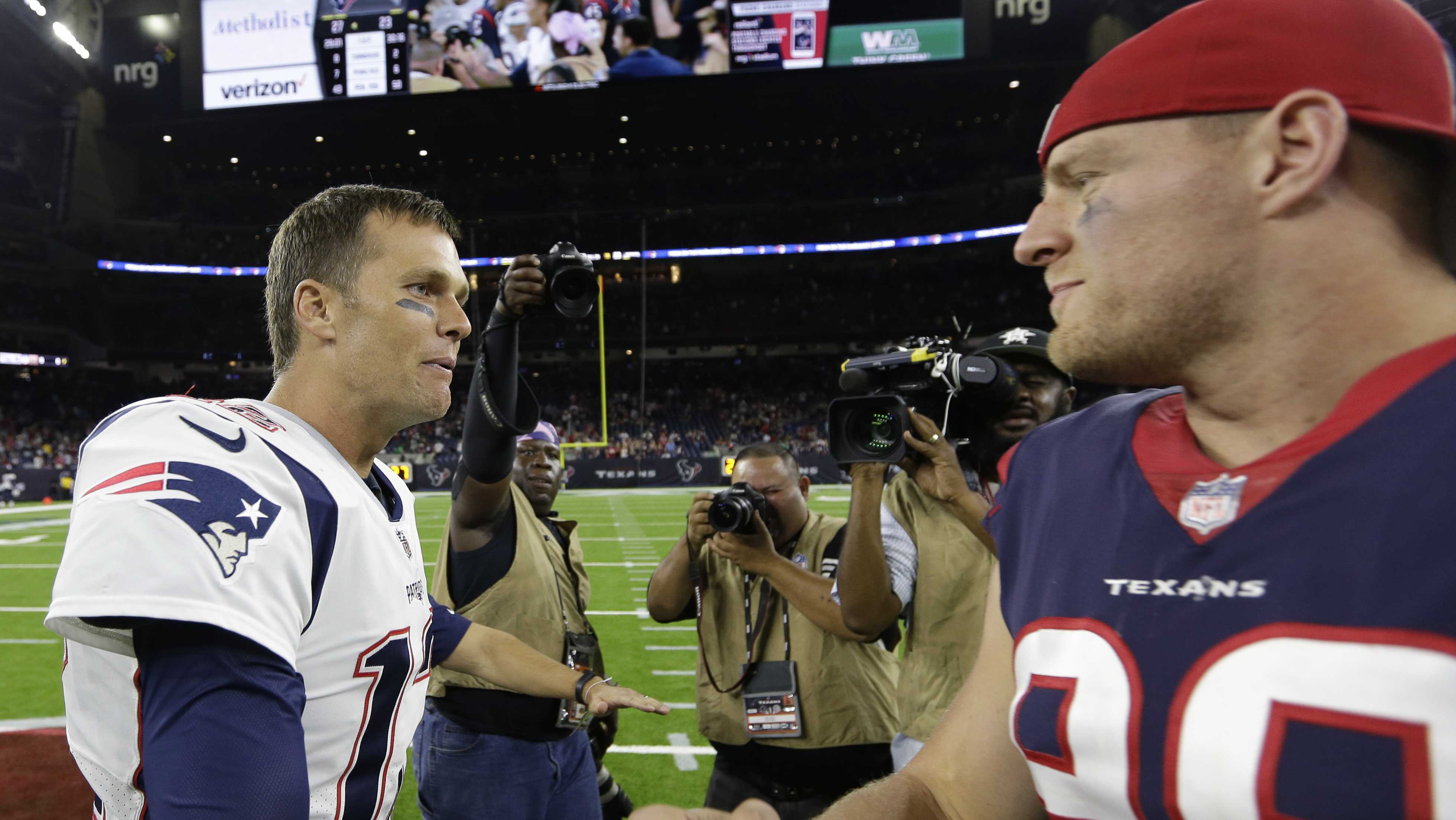 New England Patriots quarterback Tom Brady, left, greets Houston Texans defensive end J.J. Watt, right, following an NFL football preseason game Saturday, Aug. 19, 2017, in Houston.
