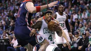 Boston Celtics guard Isaiah Thomas (4) drives to the basket against Washington Wizards center Marcin Gortat, left, during the first quarter of a second-round NBA playoff series basketball game in Boston, Tuesday, May 2, 2017.