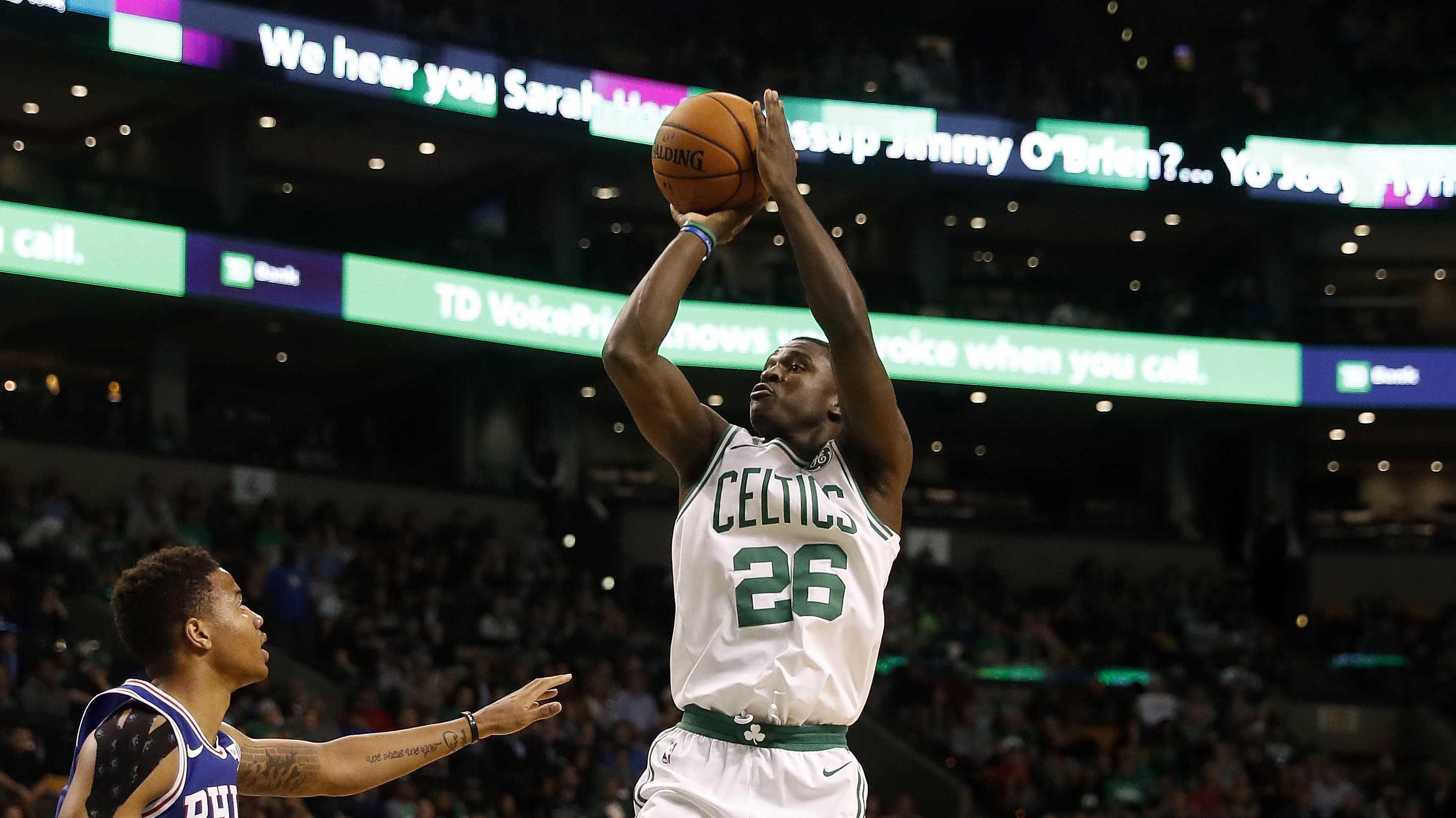 Boston Celtics guard Jabari Bird shoots during the second half of Boston's 113-96 win over the Philadelphia 76ers in a preseason NBA basketball game in Boston Monday, Oct. 9, 2017. (AP Photo/Winslow Townson)