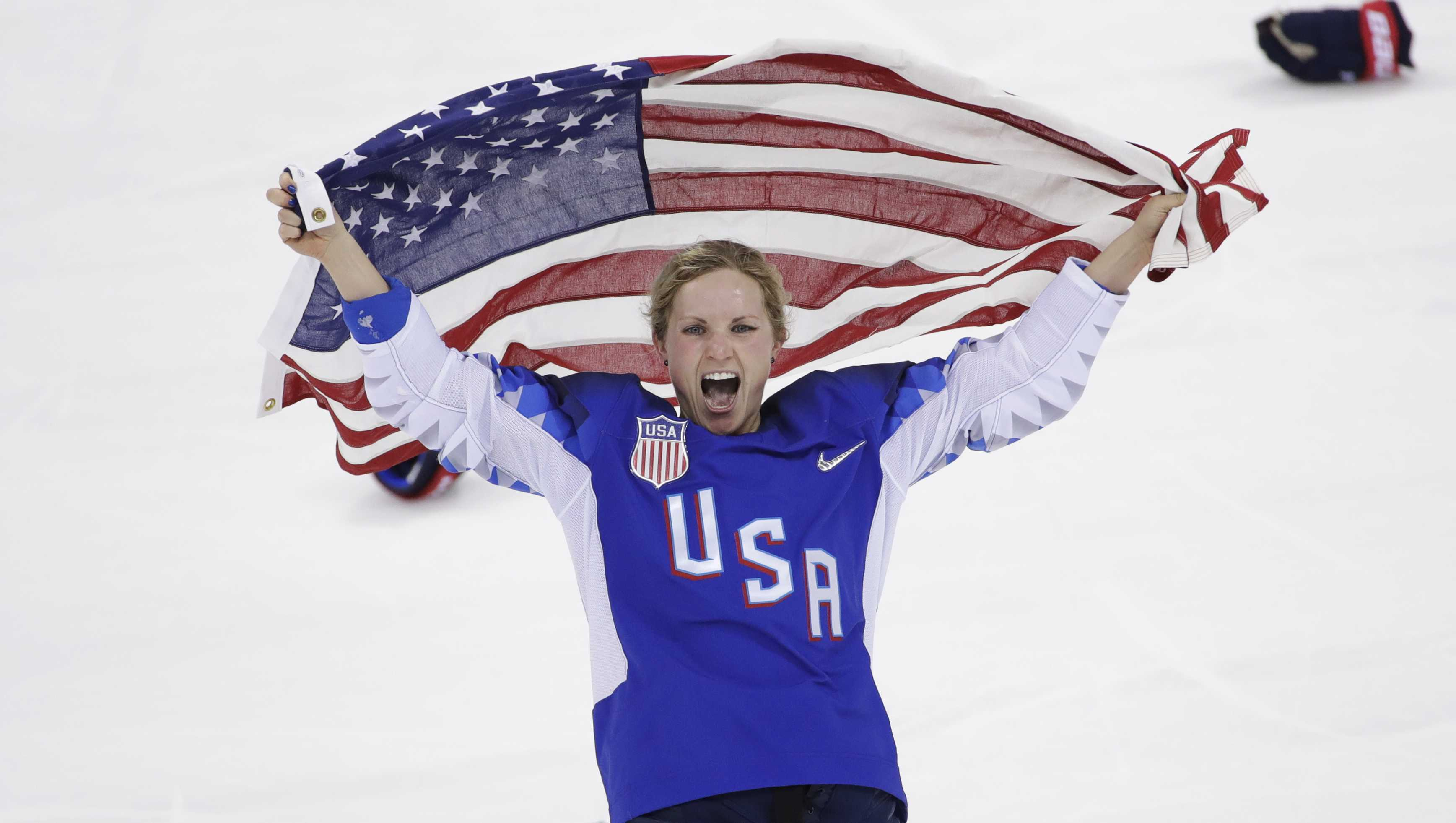 Jocelyne Lamoureux-Davidson (17), of the United States, celebrates after winning against Canada in the women's gold medal hockey game at the 2018 Winter Olympics in Gangneung, South Korea, Thursday, Feb. 22, 2018.
