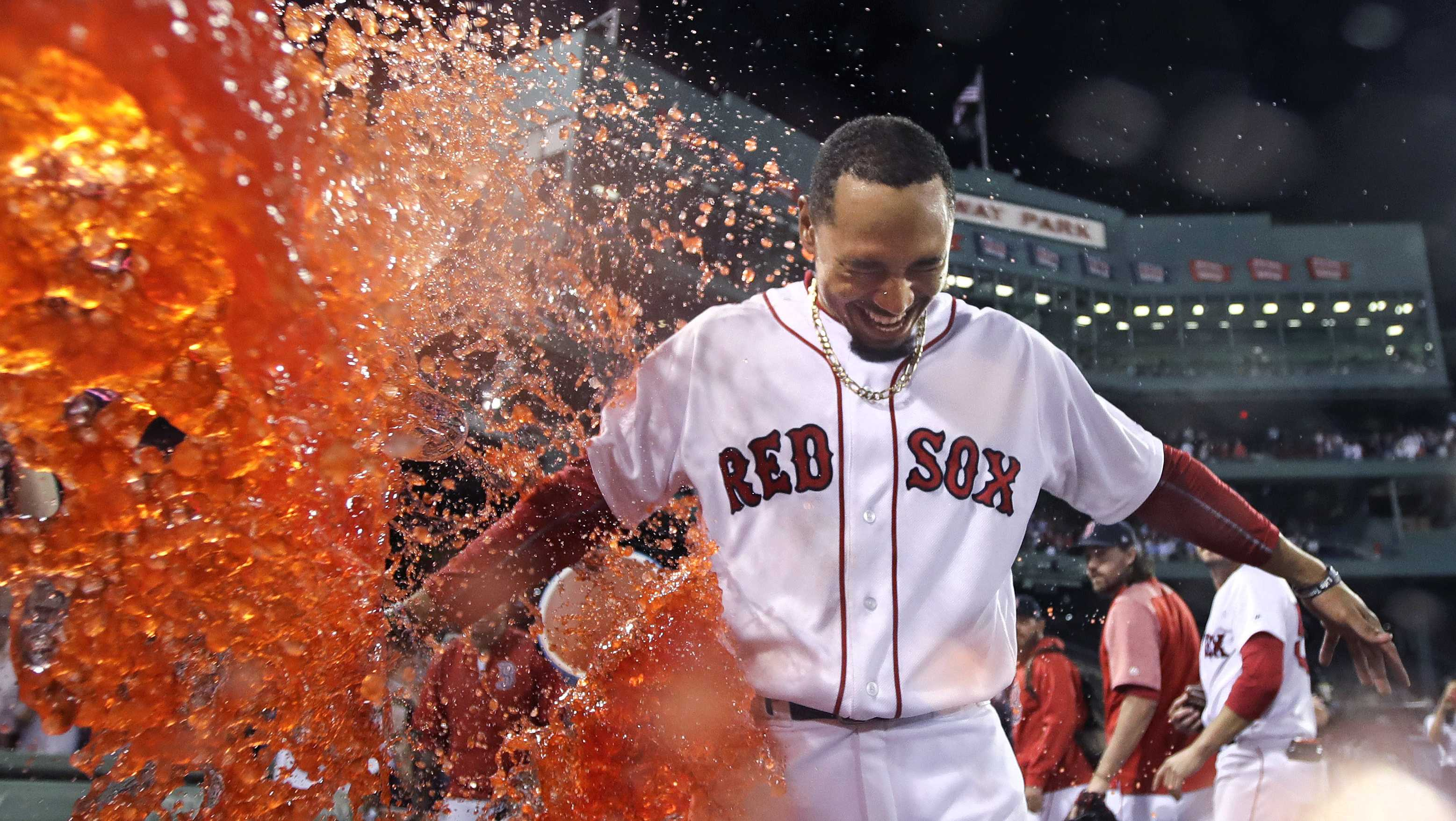 Boston Red Sox's Mookie Betts is doused after his walk-off two-run double during the ninth inning of a baseball game against the St. Louis Cardinals in Boston, Wednesday, Aug. 16, 2017. The Red Sox won 5-4.