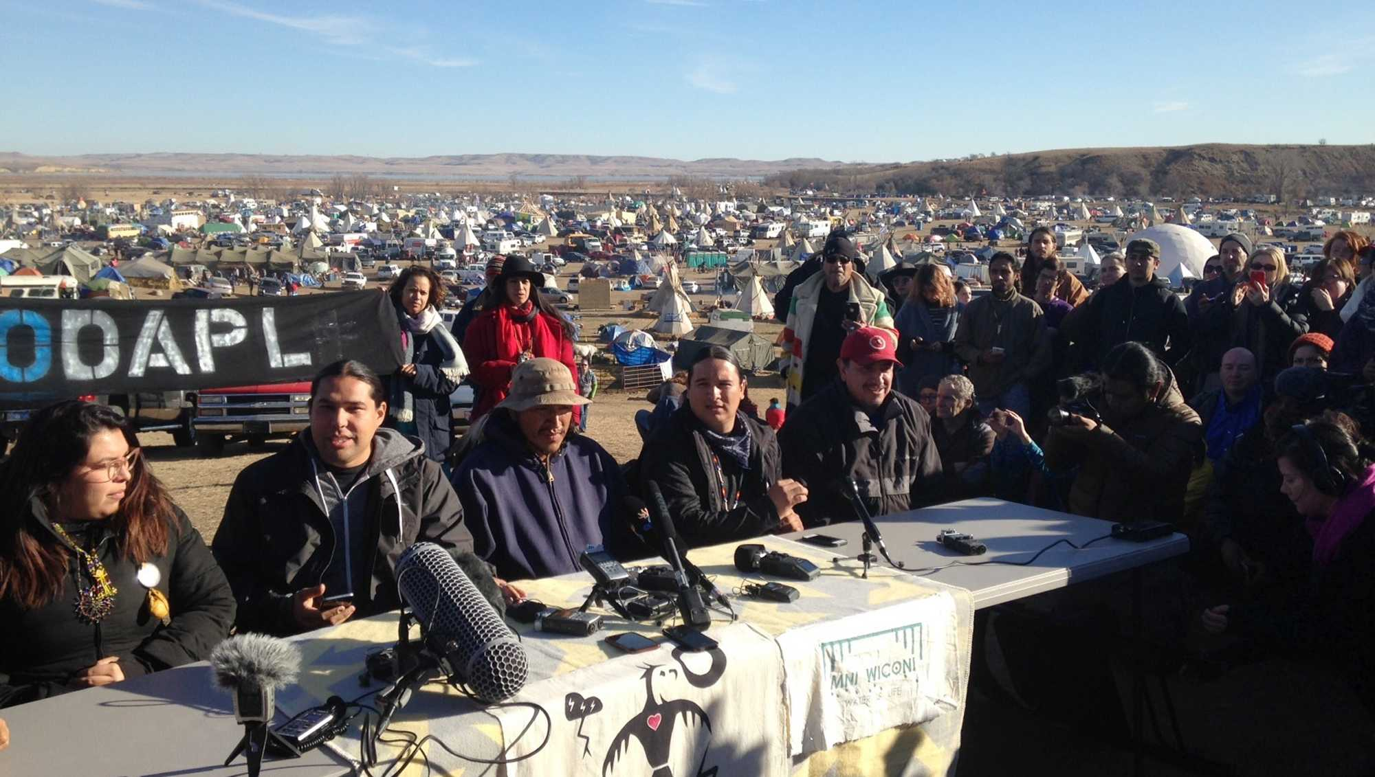 Organizers of protests against construction of the Dakota Access oil pipeline speak at a news conference on Saturday, Nov. 26, 2016, near Cannon Ball, N.D. They said they have a right to remain on land where they have been camped for months. They made the statement a day after tribal leaders received a letter from the U.S. Army Corps of Engineers, telling them the land would be closed to the public on Dec. 5.