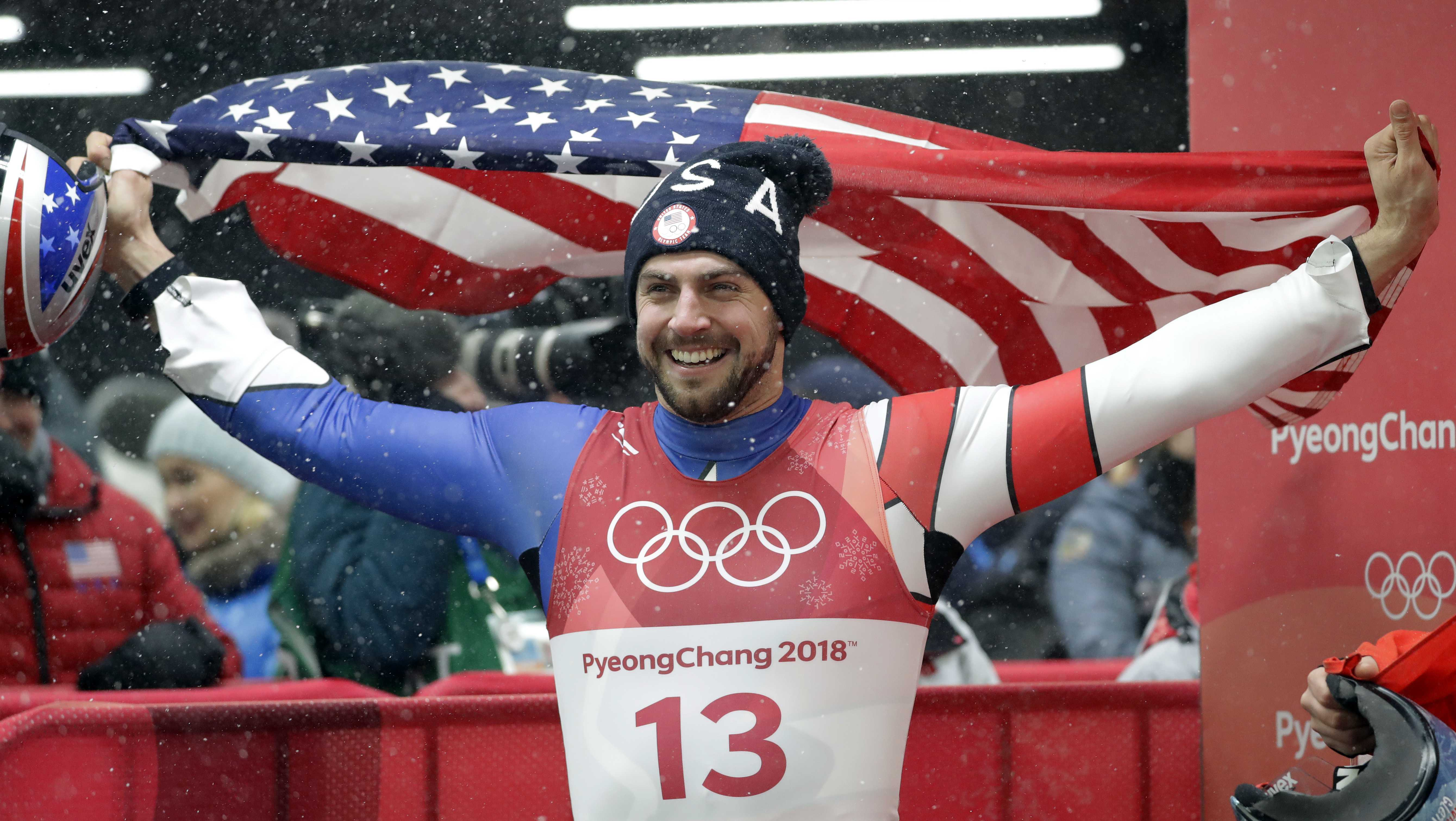 Chris Mazdzer of United States celebrates his silver medal win during final heats of the men's luge competition at the 2018 Winter Olympics in Pyeongchang, South Korea, Sunday, Feb. 11, 2018.