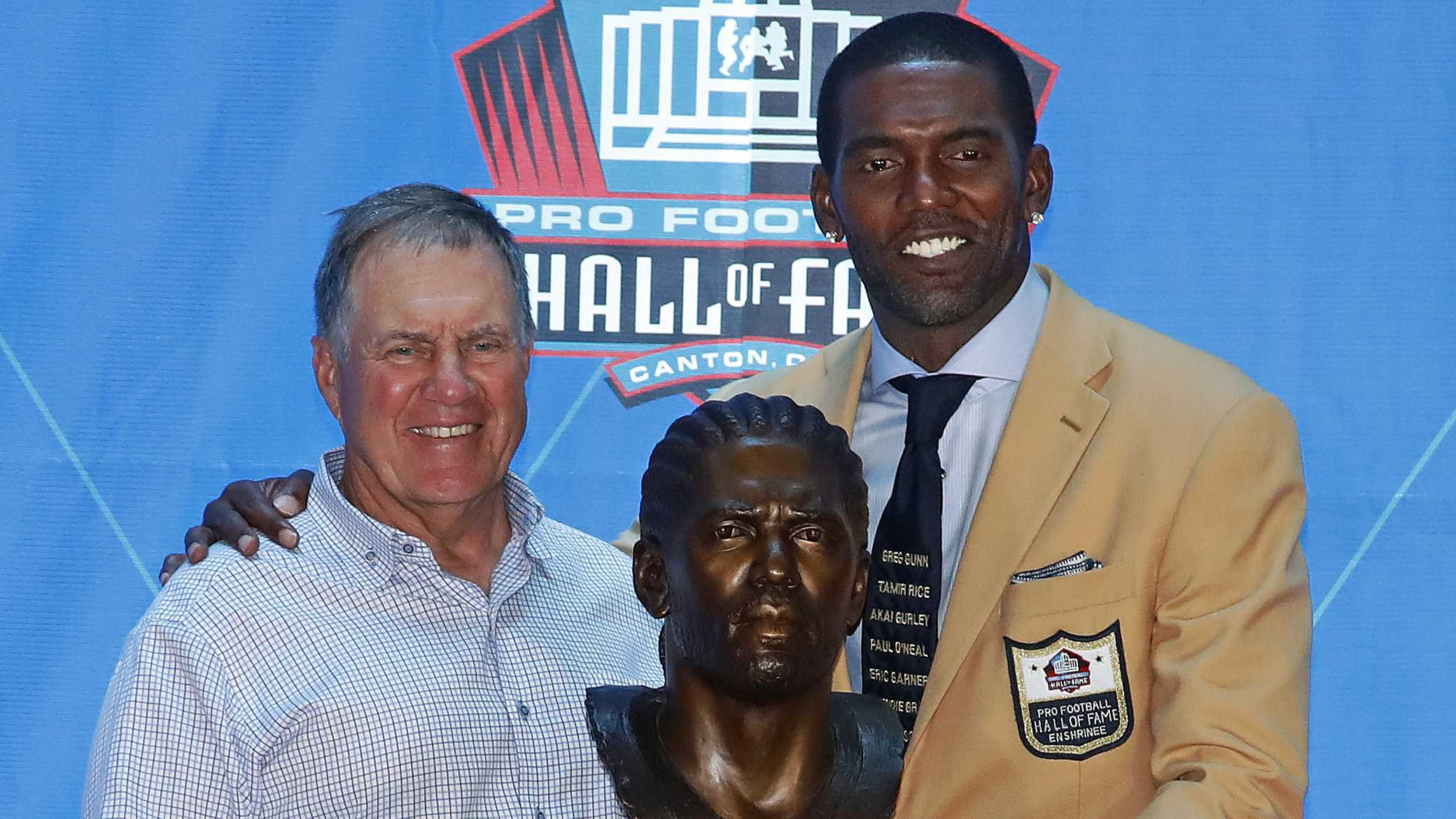 New England Patriots coach Bill Belichick, left, joins former Patriots wide receiver Randy Moss with his Pro Football Hall of Fame bust for a photo during an induction ceremony at the Pro Football Hall of Fame, Saturday, Aug. 4, 2018 in Canton, Ohio. (AP Photo/Gene J. Puskar)