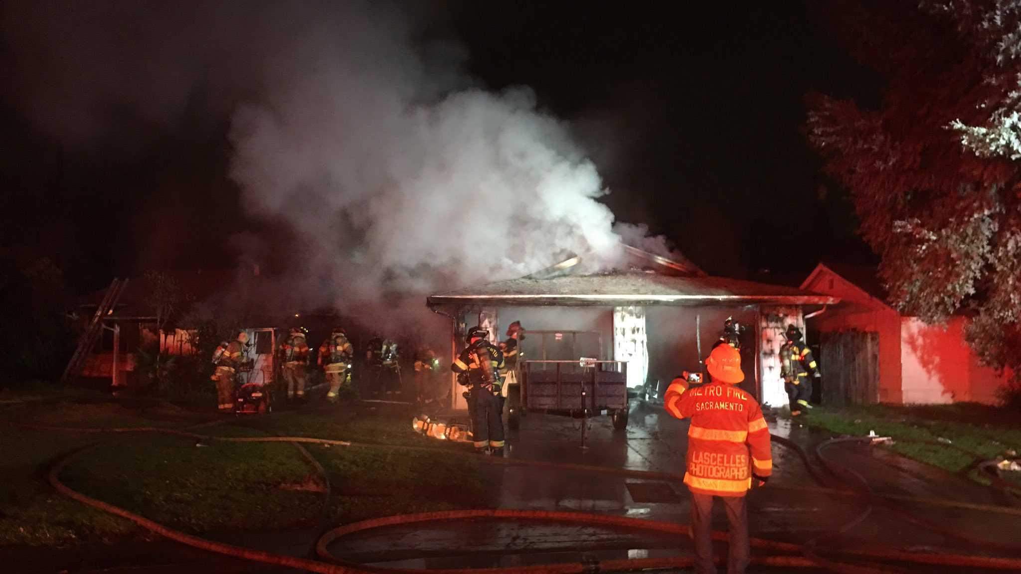 Crews fight a fire at an Arden duplex on Wednesday, Jan. 4, 2016.