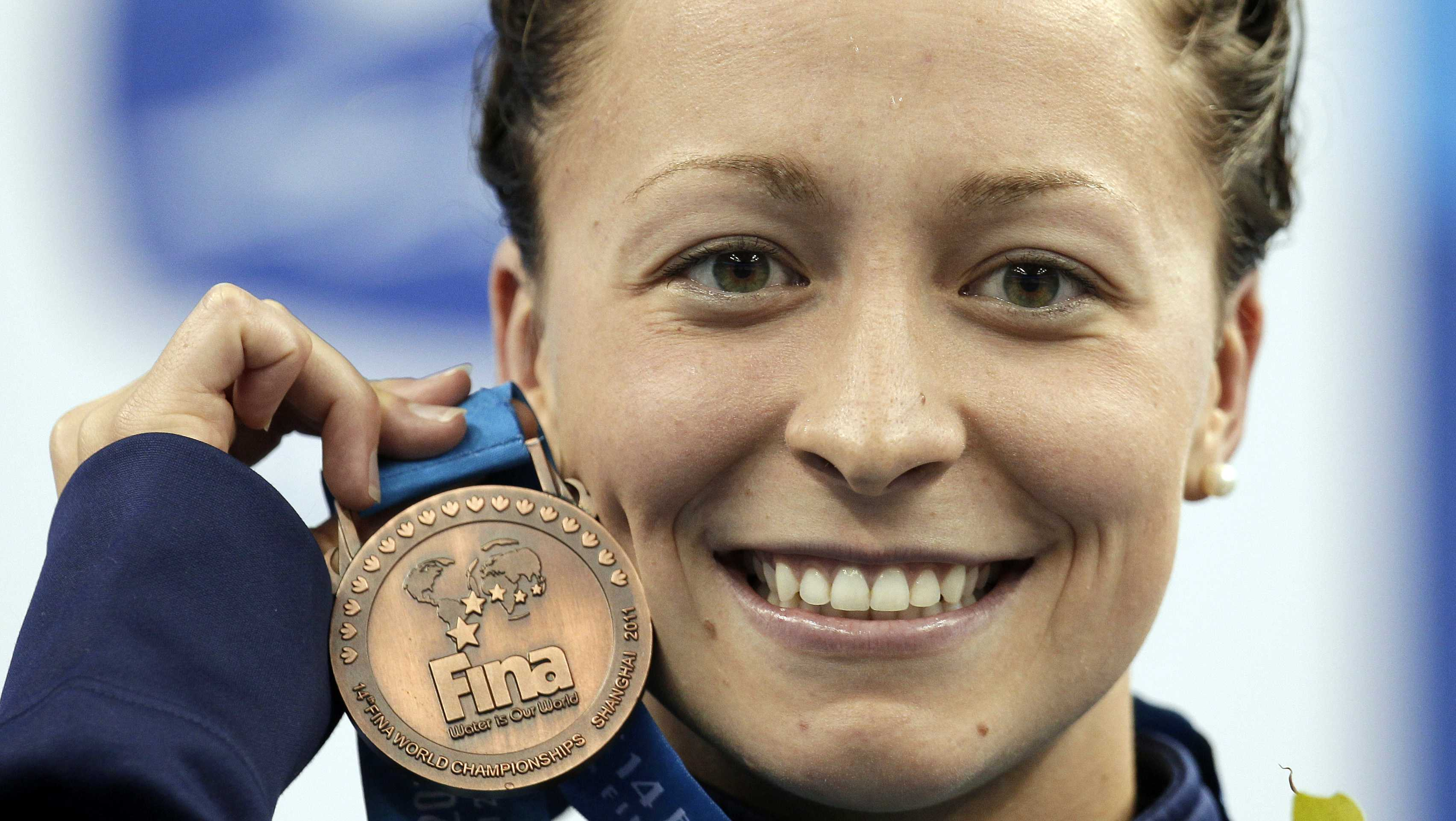 In this July 25, 2011, file photo, Ariana Kukors, of the United States, holds her bronze medal for the women's 200-meter Individual Medley final at the FINA 2011 Swimming World Championships in Shanghai, China.