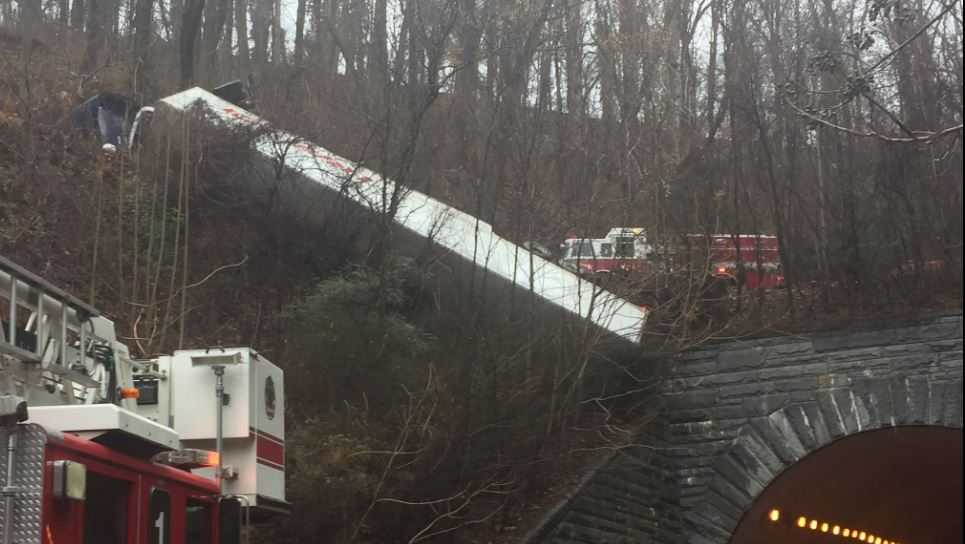 Tractor-trailer down embankment on Tunnel Road