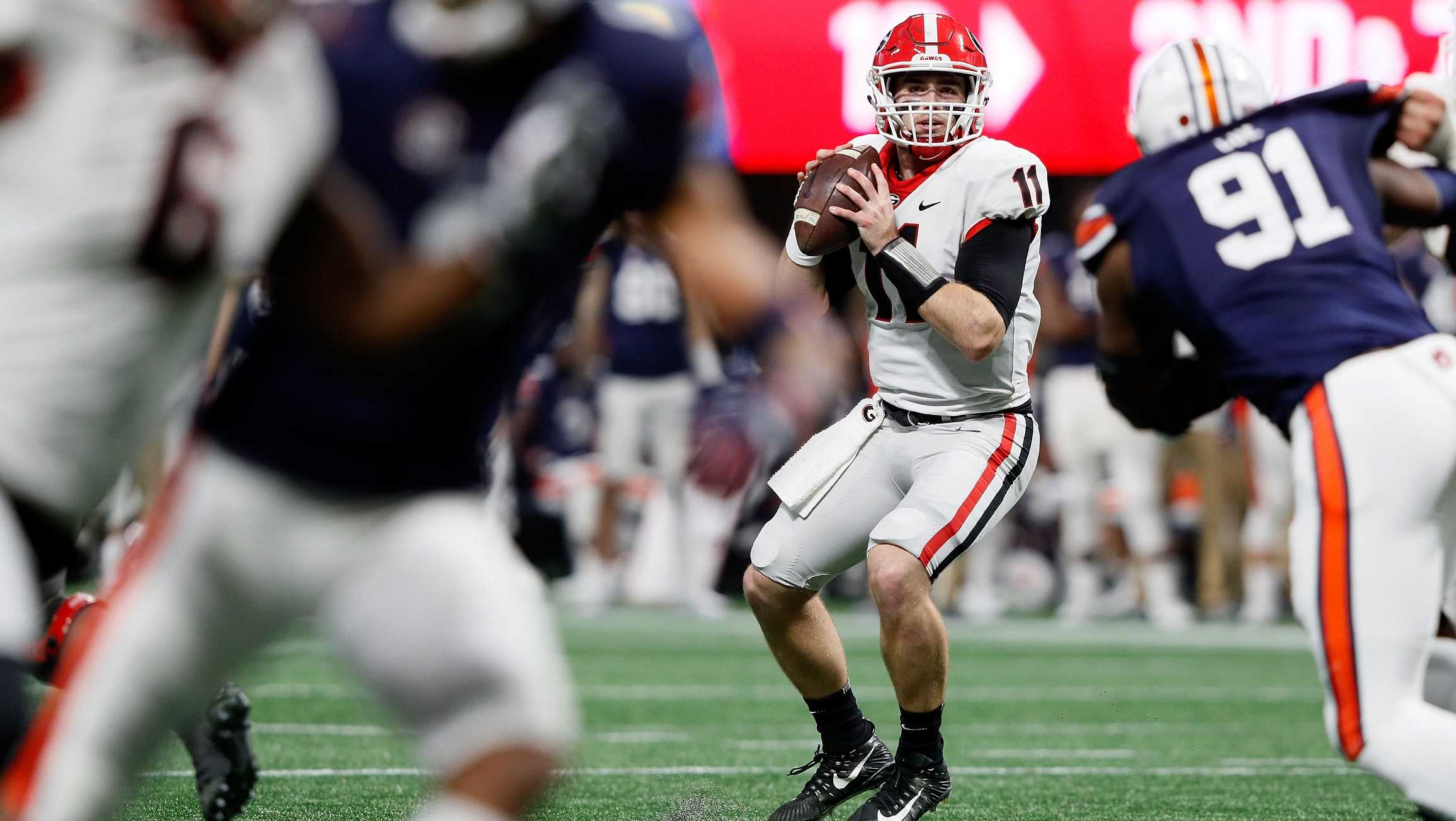 Jake Fromm, #11 of the Georgia Bulldogs, drops back to pass during the first half against the Auburn Tigers in the SEC Championship at Mercedes-Benz Stadium on December 2, 2017 in Atlanta, Georgia.