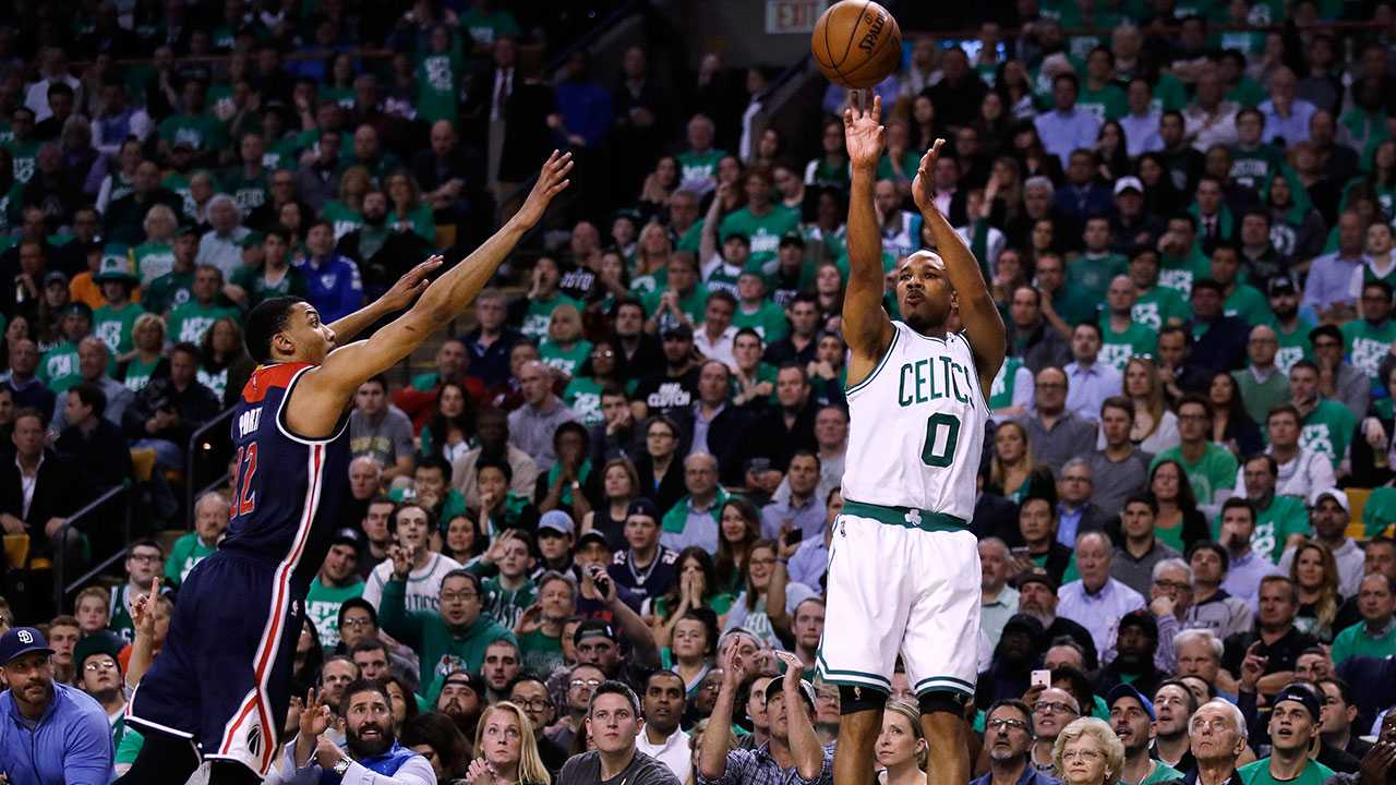 Boston Celtics guard Avery Bradley (0) shoots a 3-pointer as Washington Wizards forward Otto Porter Jr. defends during the second quarter of Game 5 of an NBA basketball second-round playoff series, in Boston, Wednesday, May 10, 2017.