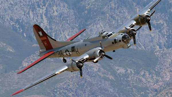 "The Experimental Aircraft Association's B-17, also known as ""Aluminum Overcast,"" banks right above Hill Air Force Base, Utah, Aug. 13, 2015. EAA's B-17 is painted to resemble B-17G No. 42-102515 of the 398th Bombardment Group (Heavy) that flew from Royal Air Force Nuthampstead, England, during World War II. ""Aluminum Overcast"" will be on static display May 17-18 at the National Museum of the U.S. Air Force as part of the new Memphis Belle™ exhibit opening. (U.S. Air Force photo/R. Nial Bradshaw)"