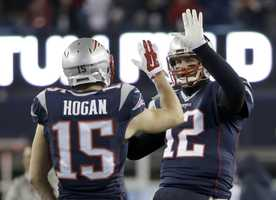 New England Patriots quarterback Tom Brady, left, speaks with Pittsburgh Steelers quarterback Ben Roethlisberger
