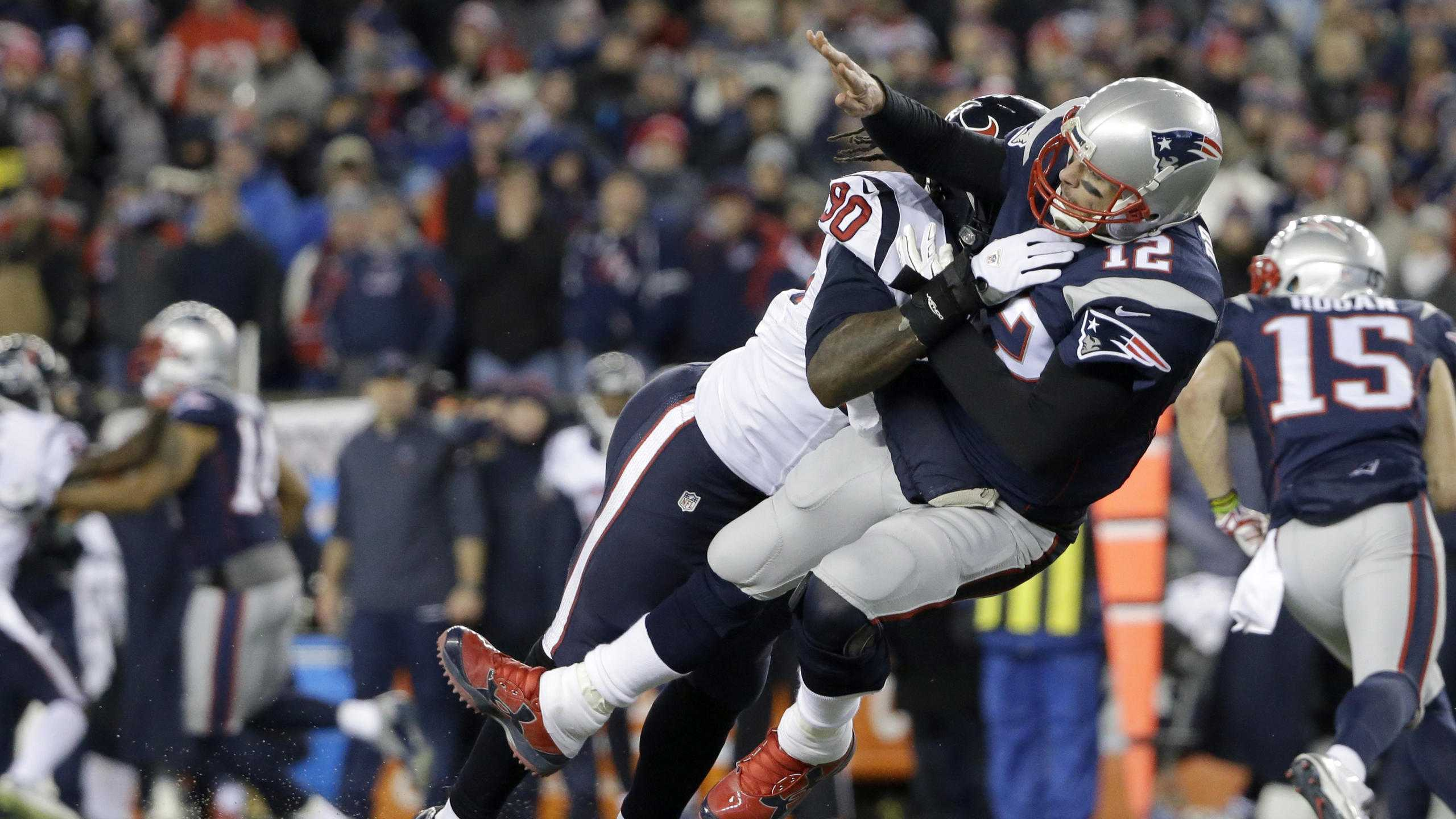 ​Houston Texans defensive end Jadeveon Clowney (90) levels New England Patriots quarterback Tom Brady (12) after Brady released a pass during the first half of an NFL divisional playoff football game, Saturday, Jan. 14, 2017, in Foxborough, Mass.