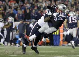 Houston Texans defensive end Jadeveon Clowney (90) levels New England Patriots quarterback Tom Brady (12) after Brady released a pass during the first half of an NFL divisional playoff football game, Saturday, Jan. 14, 2017, in Foxborough, Mass.