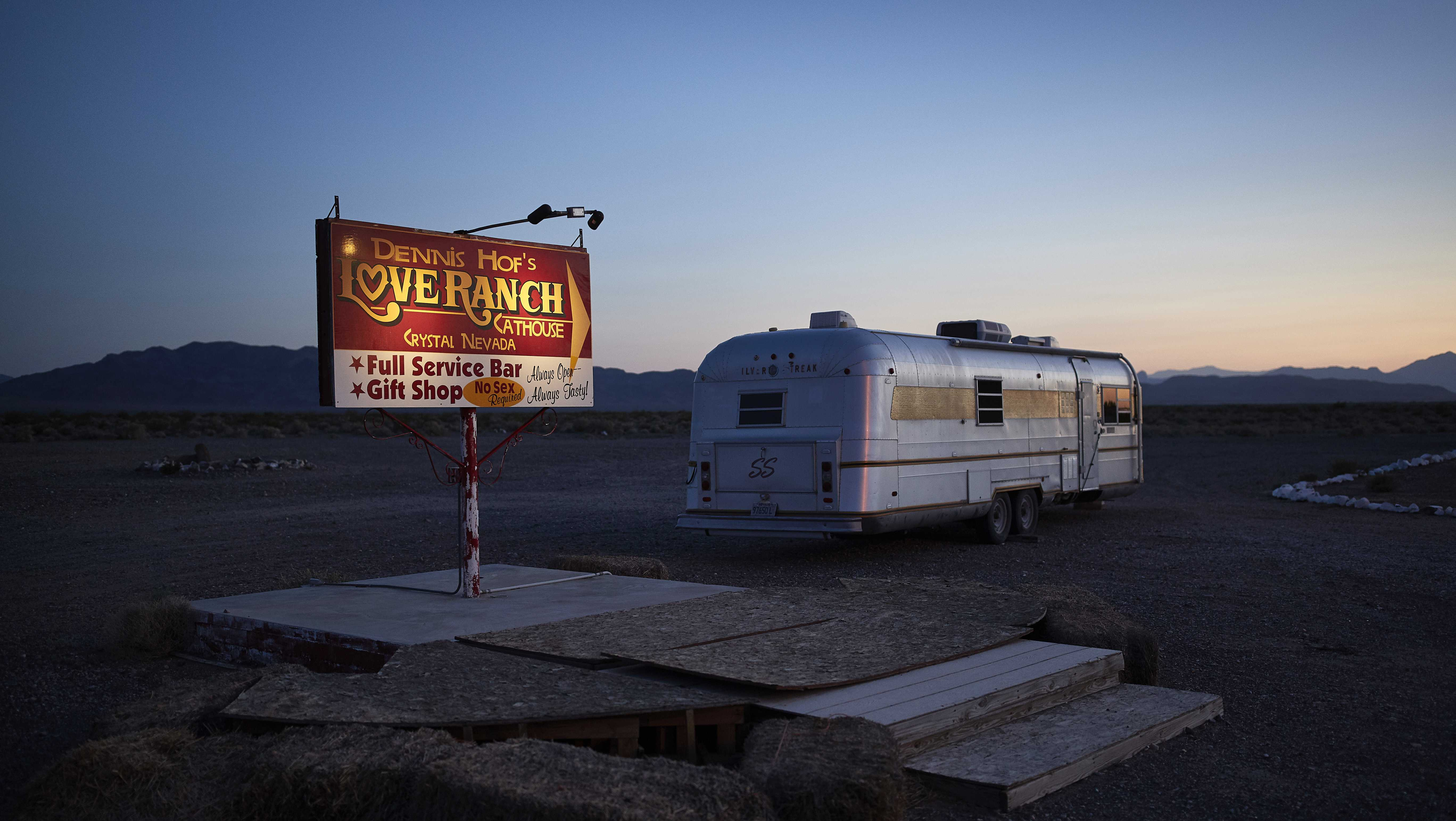In this April 27, 2018, photo, a sign advertises the Love Ranch brothel in Crystal, Nev. A coalition of religious groups and anti-sex trafficking activists have launched referendums to ban brothels in two of Nevada's seven counties where they legally operate.