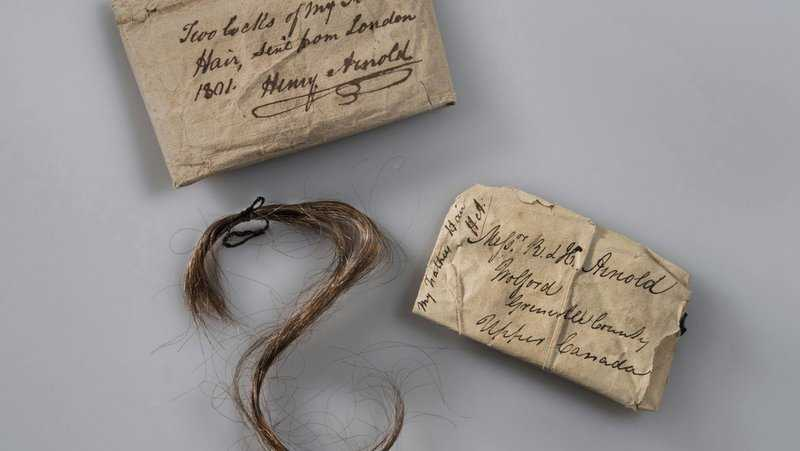 This 2017 photo provided by Fort Ticonderoga shows a lock of Benedict Arnold's hair along with the paper wrappings that have enclosed it, at Fort Ticonderoga, in Ticonderoga, N.Y.