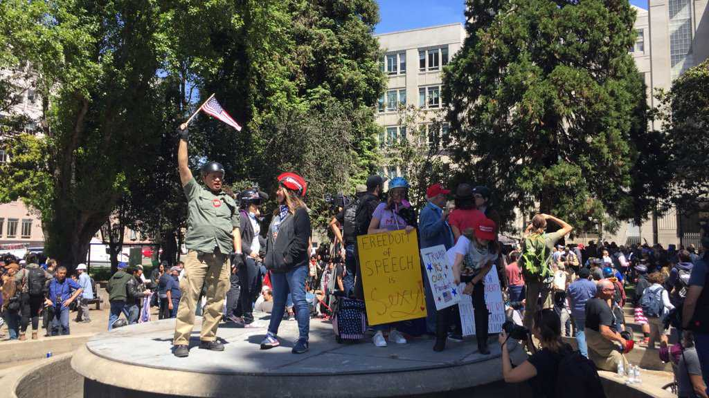 Hundreds of people protested Thursday, April 27, 2017, at a park in Berkeley after the university cancelled a speech by Ann Coulter.