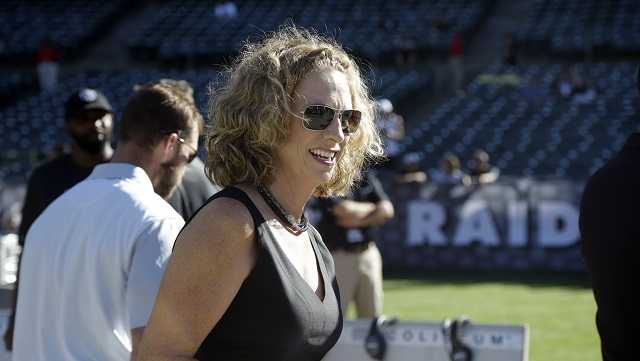 "In this Aug. 14, 2015, file photo, announcer Beth Mowins walks on the field before an NFL preseason football game between the Oakland Raiders and the St. Louis Rams in Oakland, Calif. ESPN announced May 16, 2017, that Mowins will call the second part of a season-opening ""Monday Night Football"" doubleheader in September, making her the first woman do play-by-play duties on an NFL game in 30 years."