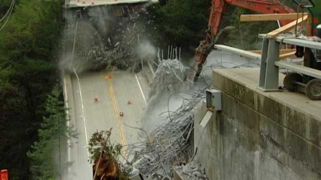 The Pfeiffer Bridge was demolished Friday afternoon after days of using a crane to break the foundation.