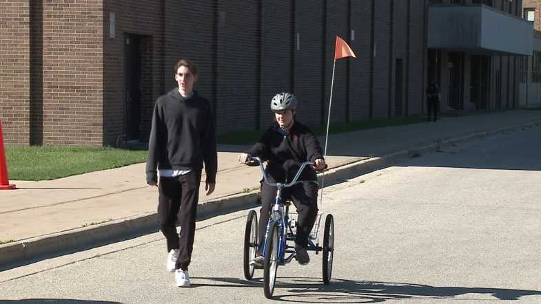 High school students with disabilities learn to ride bike for first time