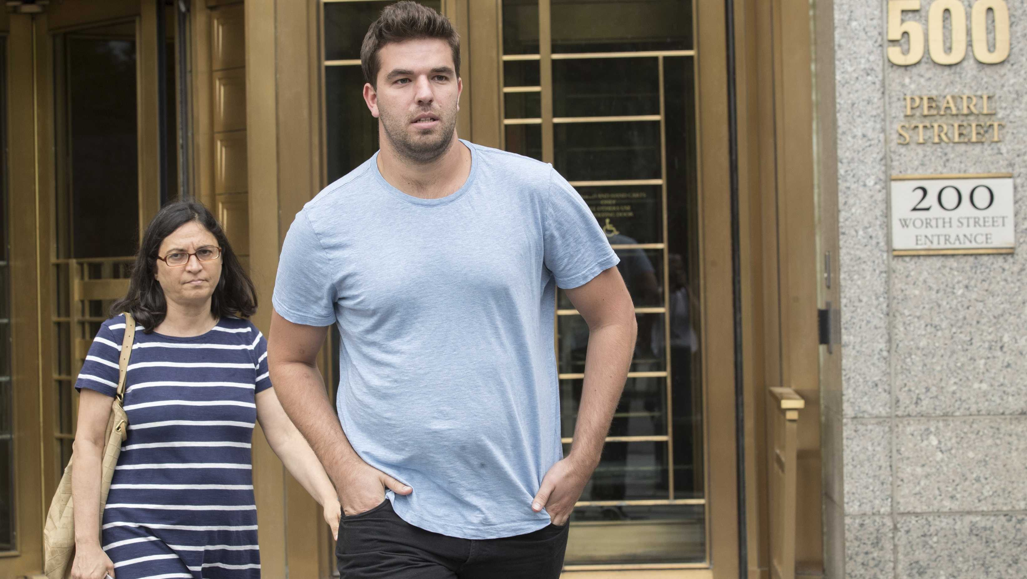 Billy McFarland, right, leaves federal court with his attorney Sabrina Shroff after his arraignment, Saturday, July 1, 2017, in New York. McFarland is charged with scheming to defraud investors in his company, Fyre Media.