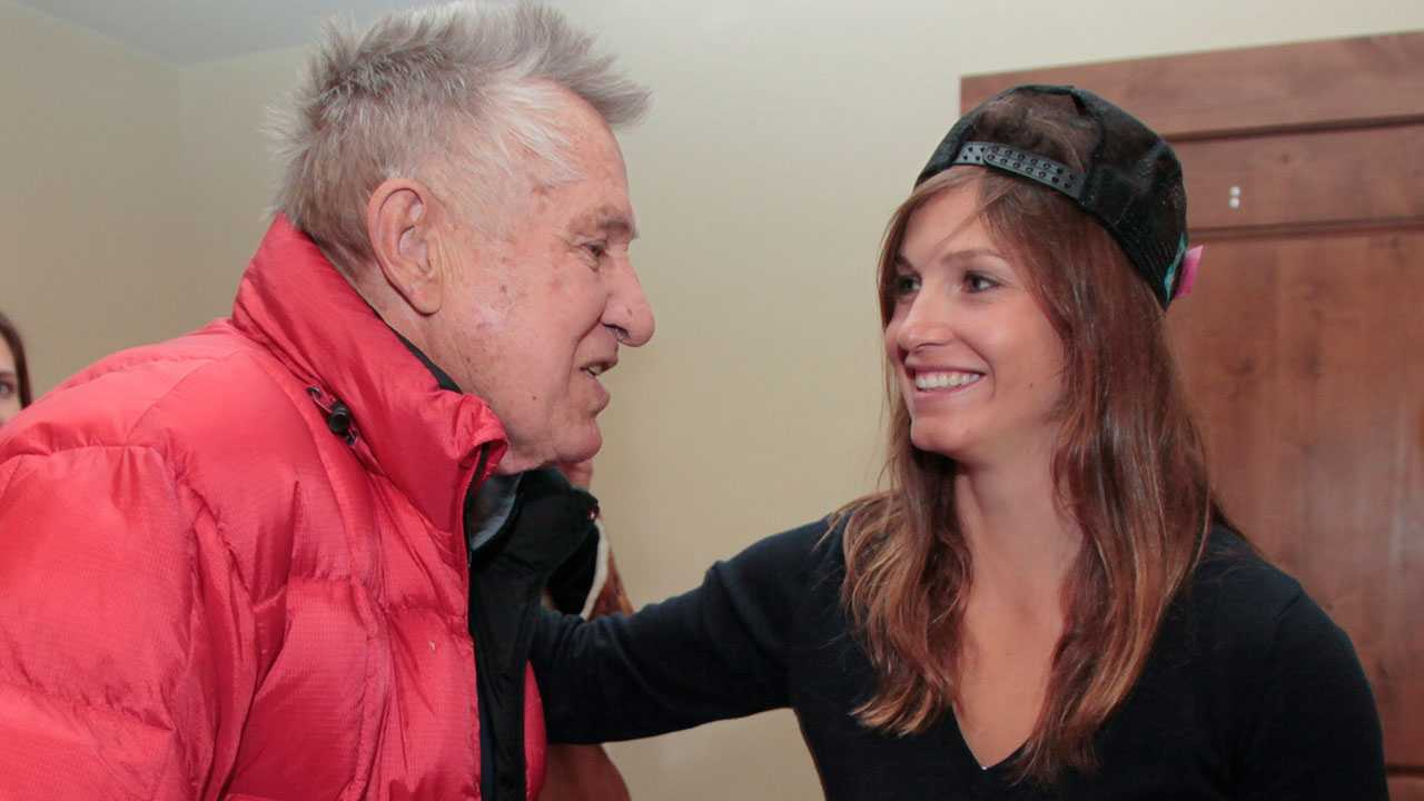 FILE - In this Nov. 25, 2011, file photo, Bob Beattie, left, and Olympic gold medal skier Julia Mancuso chat during an autograph session in Aspen, Colo. Bob Beattie, a ski racing pioneer who helped launch the Alpine World Cup circuit more than 50 years ago, has died. He was 85. His son, Zeno, said Beattie died Sunday, April 1, 2018, in Fruita, Colorado, after dealing with health issues.
