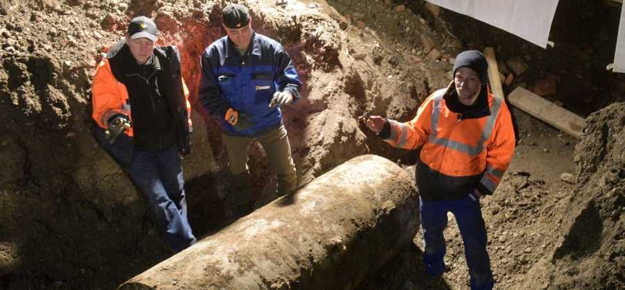 In this Dec. 25, 2016 picture, explosives experts stand next to a WWII bomb after the successful defusing in Augsburg, Germany. Explosives experts have defused the large World War II aerial bomb in the southern German city of Augsburg - clearing the way for thousands of evacuated residents to return and hold their Christmas celebrations at home.