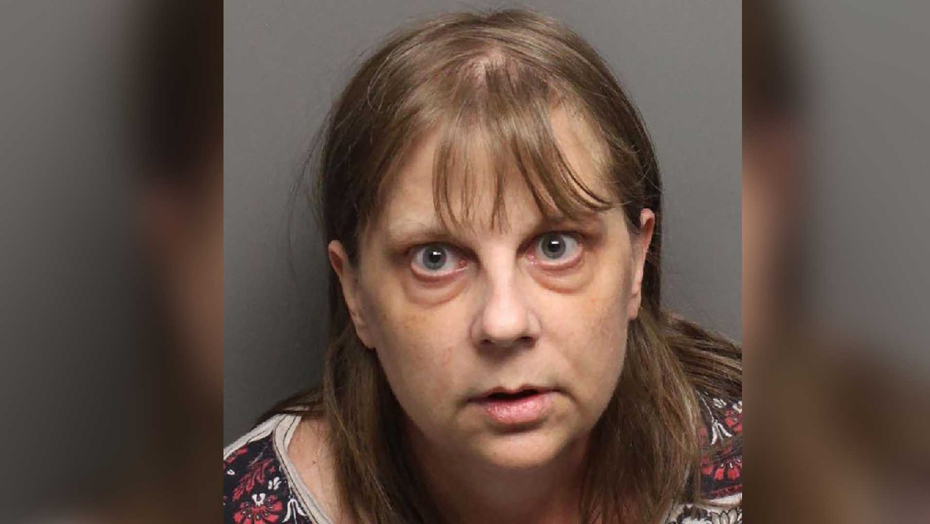 A 54-year-old Auburn woman was arrested after hitting a pedestrian in a parking lot Friday, the Auburn Department of Public Safety said.
