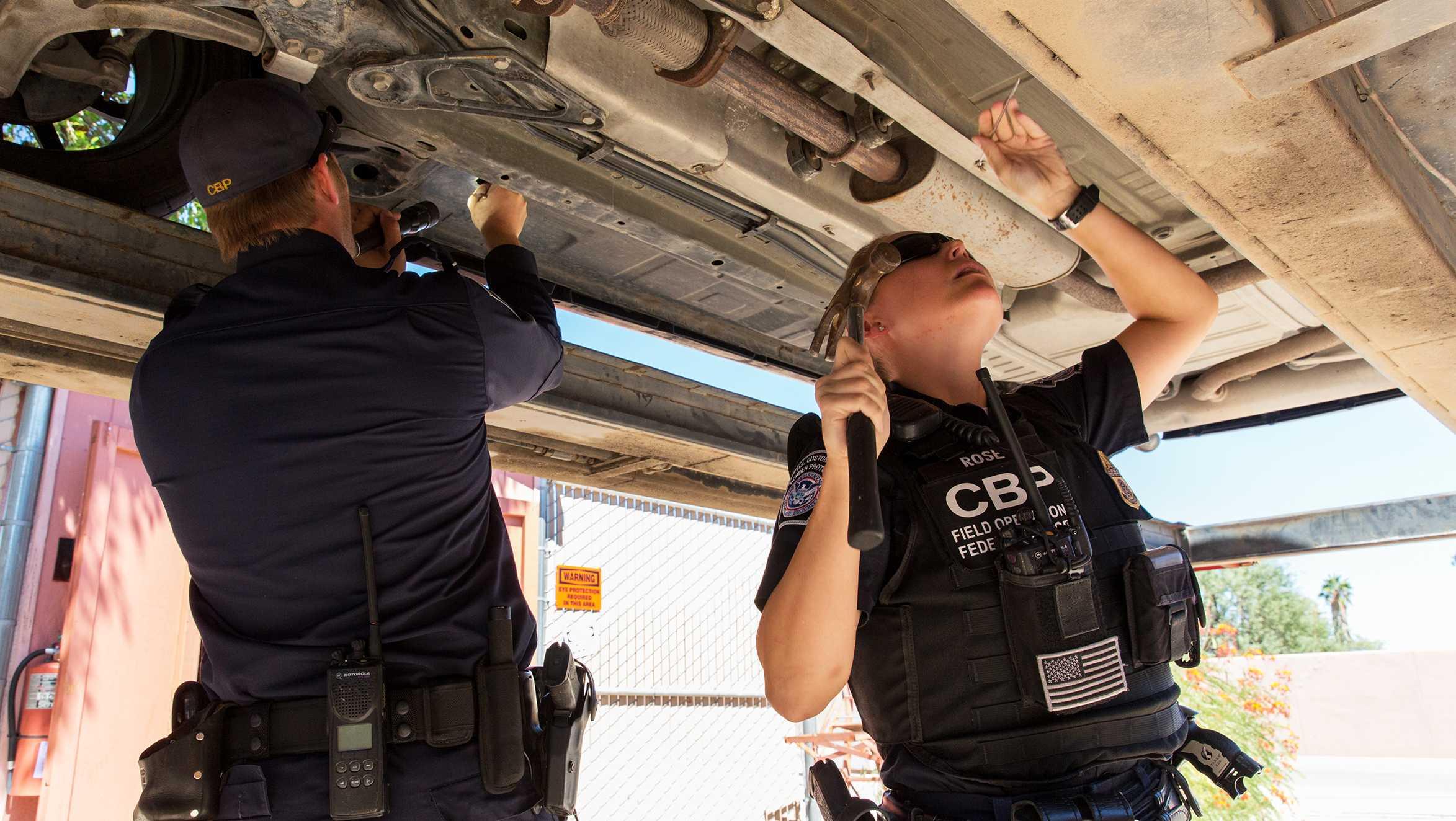 U.S. border agents search a car
