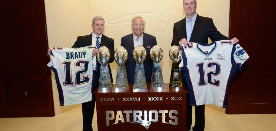 FBI Boston Division Special Agent in Charge Harold H. Shaw (left) and Massachusetts State Police Colonel Richard D. McKeon (right) return two stolen jerseys worn by New England Patriots MVP Tom Brady during Super Bowl 49 and Super Bowl 51 to Chairman and CEO of the New England Patriots Robert Kraft at Gillette Stadium in Foxboro, Massachusetts on March 23, 2017.