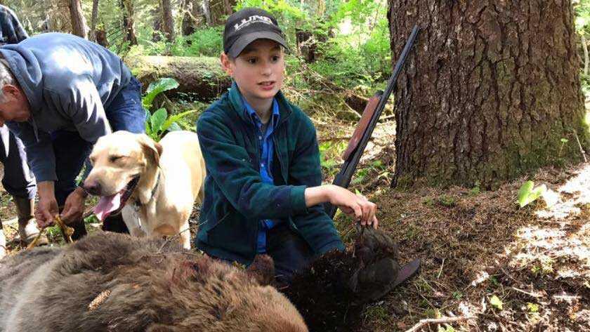 Boy, 11, shoots charging bear to save fishing party in Alaska