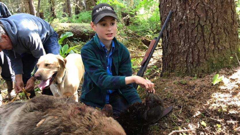 Eliot, 11, with the bear he shot in Alaska