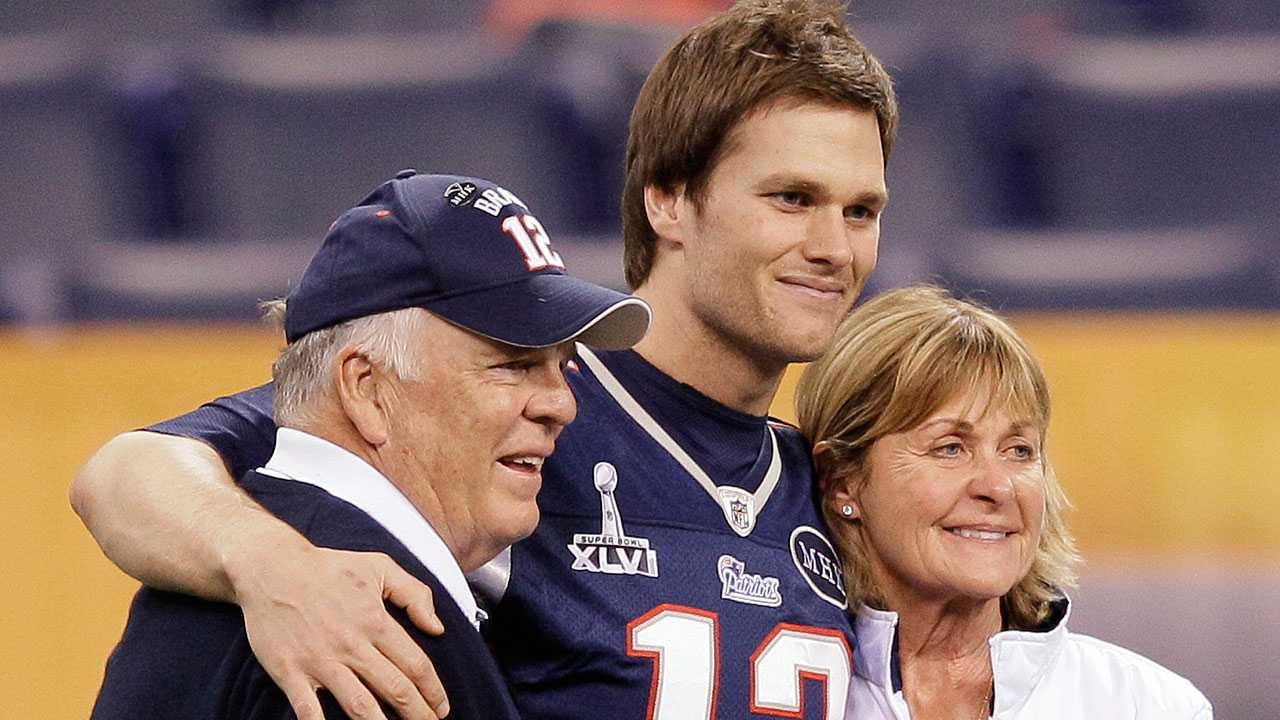 New England Patriots quarterback Tom Brady (12) poses for a photo with his parents, Tom and Galynn Brady, in Lucas Oil Stadium on Saturday, Feb. 4, 2012, in Indianapolis. The Patriots are scheduled to face the New York Giants in NFL football Super Bowl XLVI on Feb. 5.